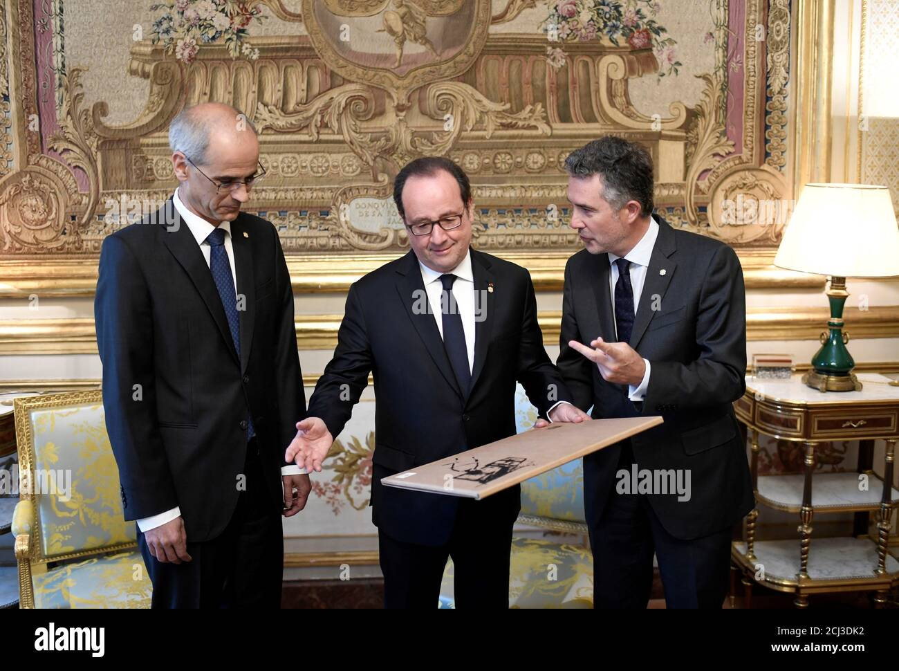 French President Francois Hollande C Receives A Present From Andorra S Head Of Government Antoni Marti Petit