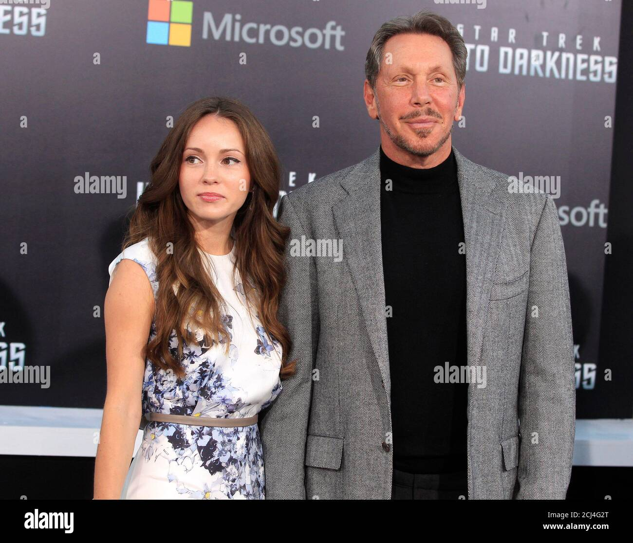 "Oracle CEO Larry Ellison and Nikita Kahn arrive as guests for the premiere of the new film ""Star Trek Into Darkness"" in Hollywood May 14, 2013. Ellison's son David is the executive producer of the film. REUTERS/Fred Prouser (UNITED STATES - Tags: ENTERTAINMENT BUSINESS) Stock Photo"