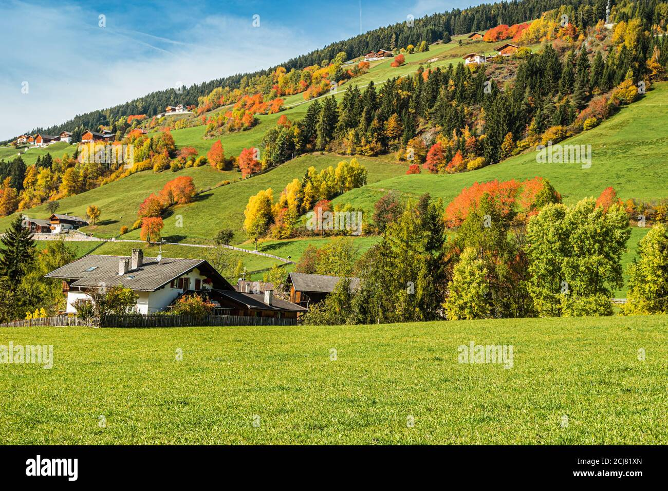 Early autumn in the village of Santa Magdalena in northern Italy on the slopes of the Dolomites in the valley of Val di Funes. Stock Photo