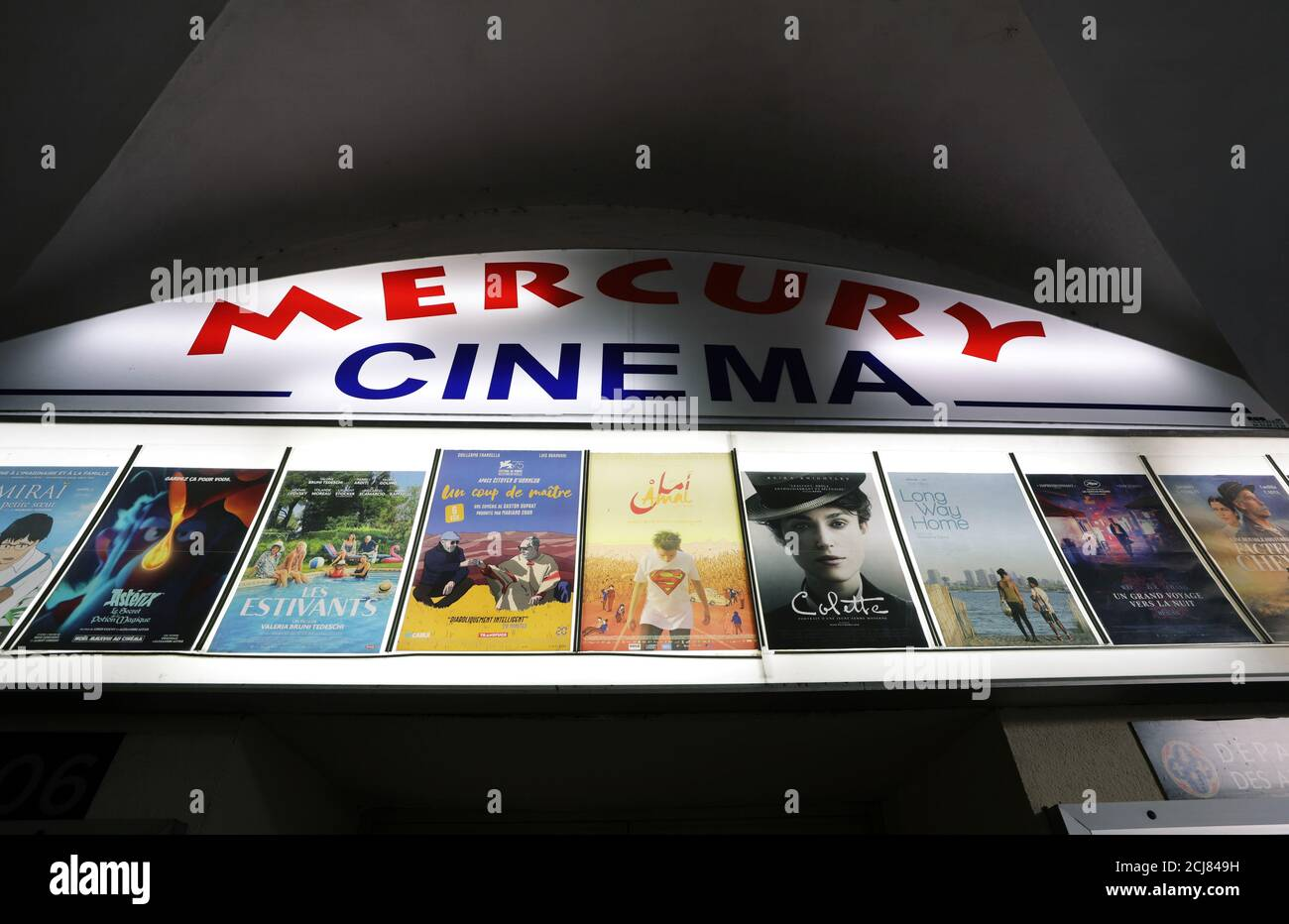 Movie posters are seen outside the cinema Mercury in Nice, France