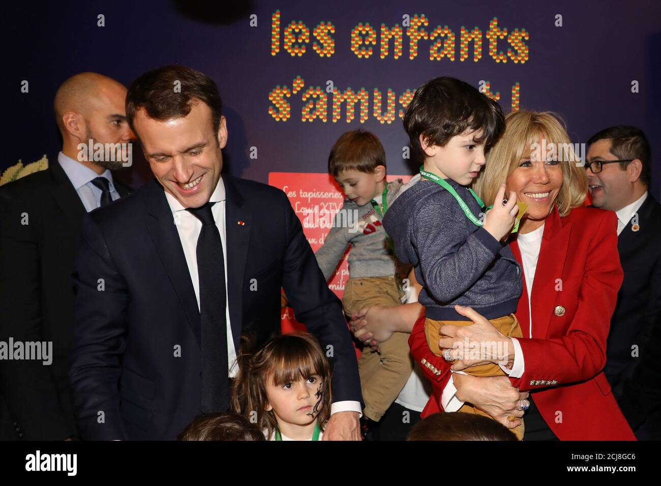 French President Emmanuel Macron And His Wife Brigitte Macron Meet Children During The Christmas Party For