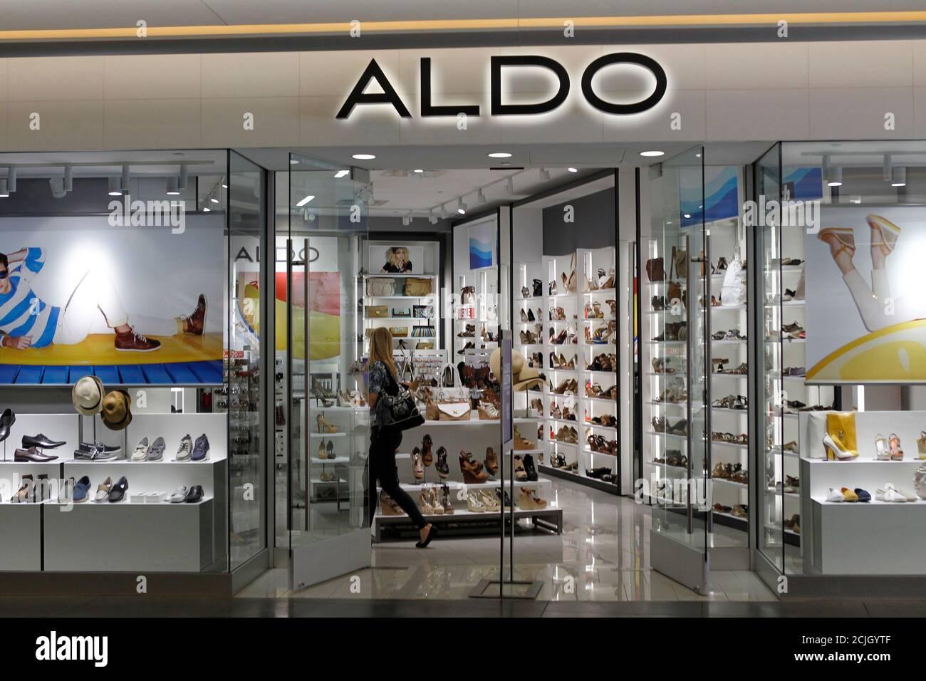 customer shops in an Aldo shoe boutique