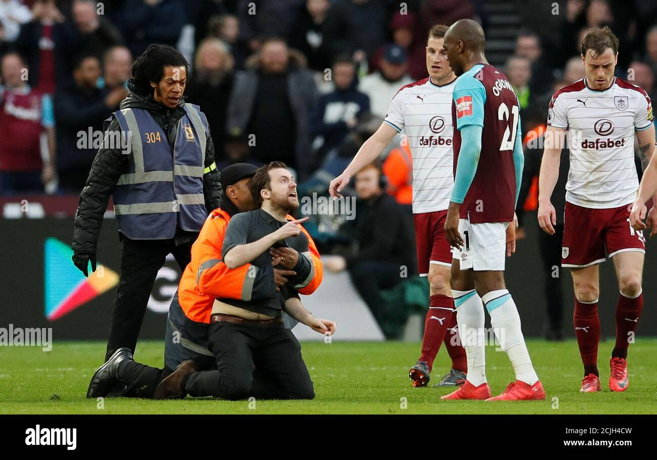 Soccer Football Premier League West Ham United Vs Burnley London Stadium London Britain March 10 2018 Fan Is Tackled By Stewards After Invading The Pitch Reuters David Klein Editorial