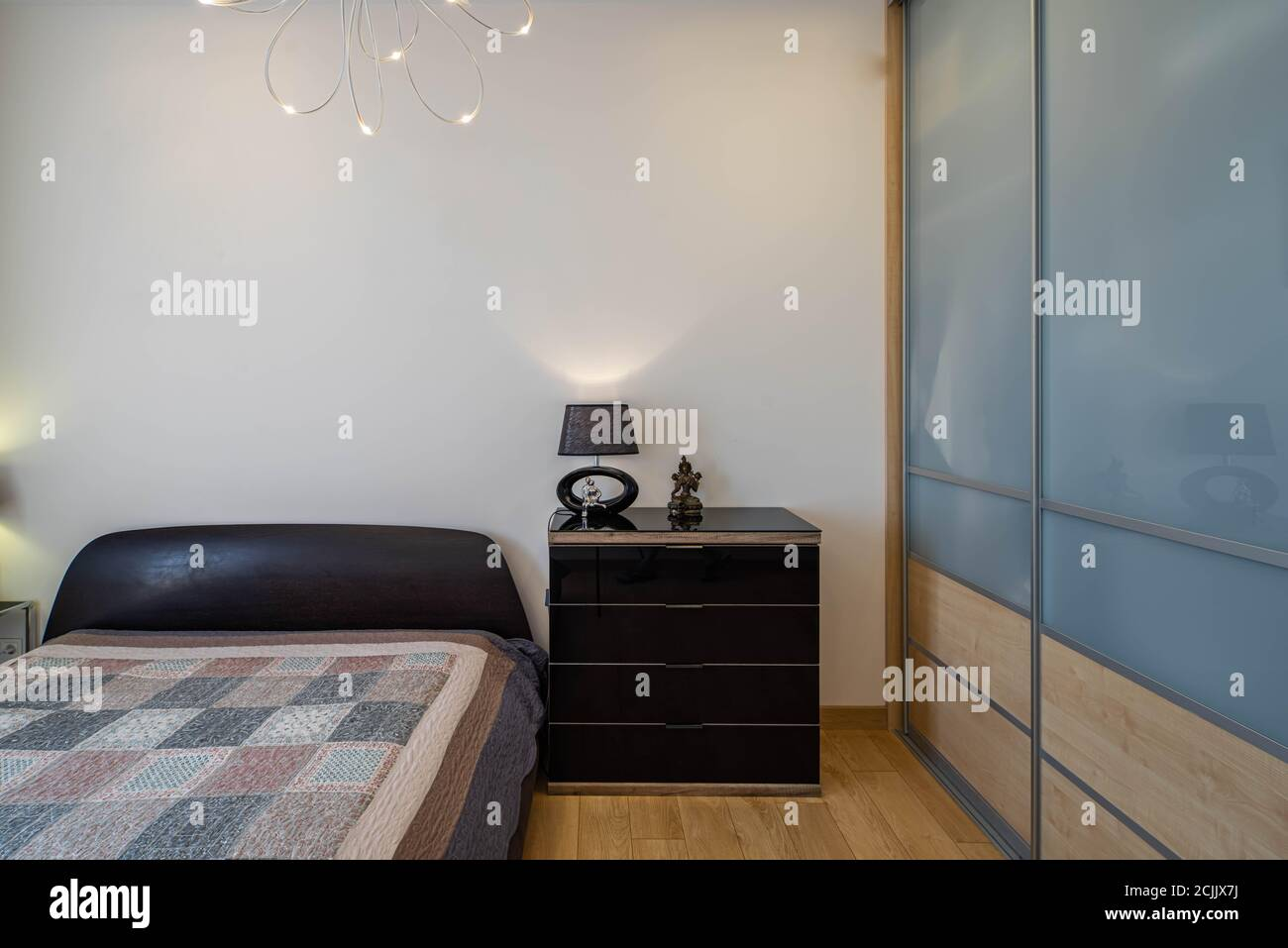 Modern Interior Of Bedroom In Apartment Glass Sliding Door Wardrobe Stylish Dresser Cozy Bed Stock Photo Alamy