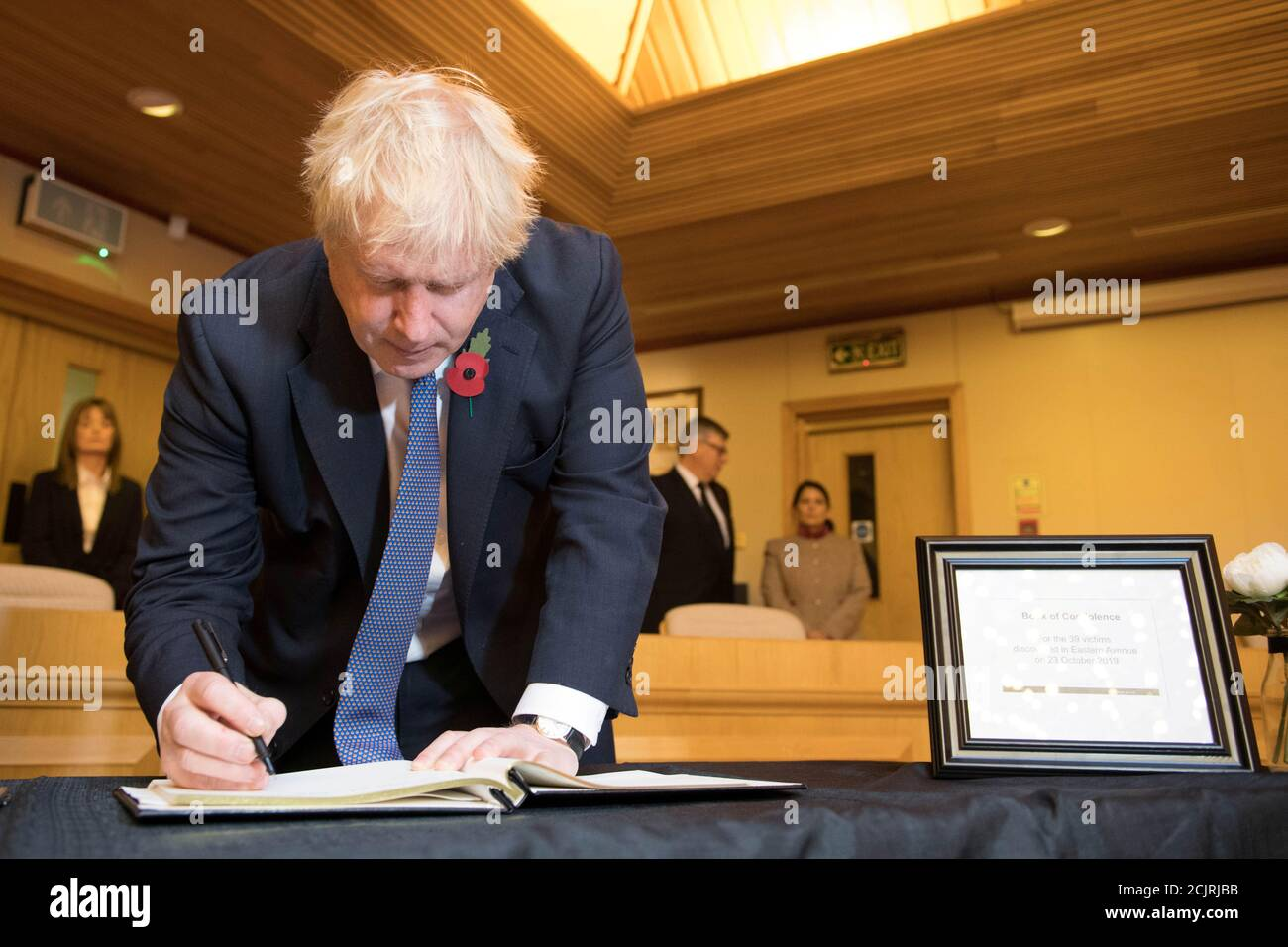 Britain's Prime Minister Boris Johnson signs a book of condolence during a visit to Thurrock Council Offices in Grays, Britain, October 28, 2019. Stefan Rousseau/Pool via REUTERS Stock Photo