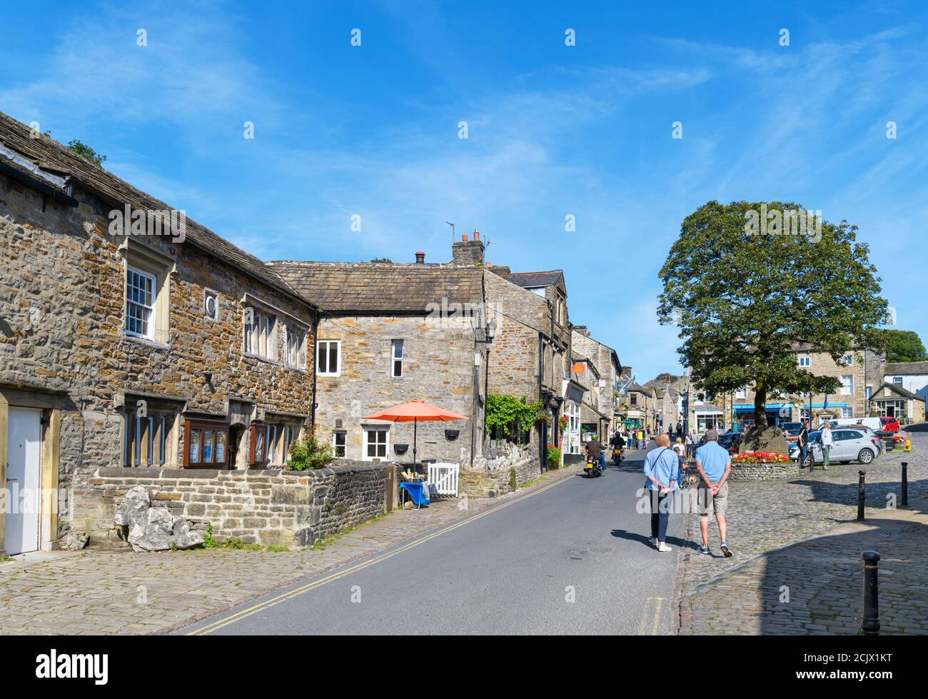 The Square and Main Street in the  traditional English village of Grassington, Wharfedale, Yorkshire Dales National Park, North Yorkshire, England, UK Stock Photo