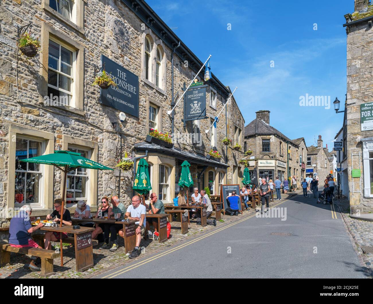 The Devonshire Inn on the Main Street in the traditional English village of Grassington, Yorkshire Dales National Park, North Yorkshire, England, UK. Stock Photo