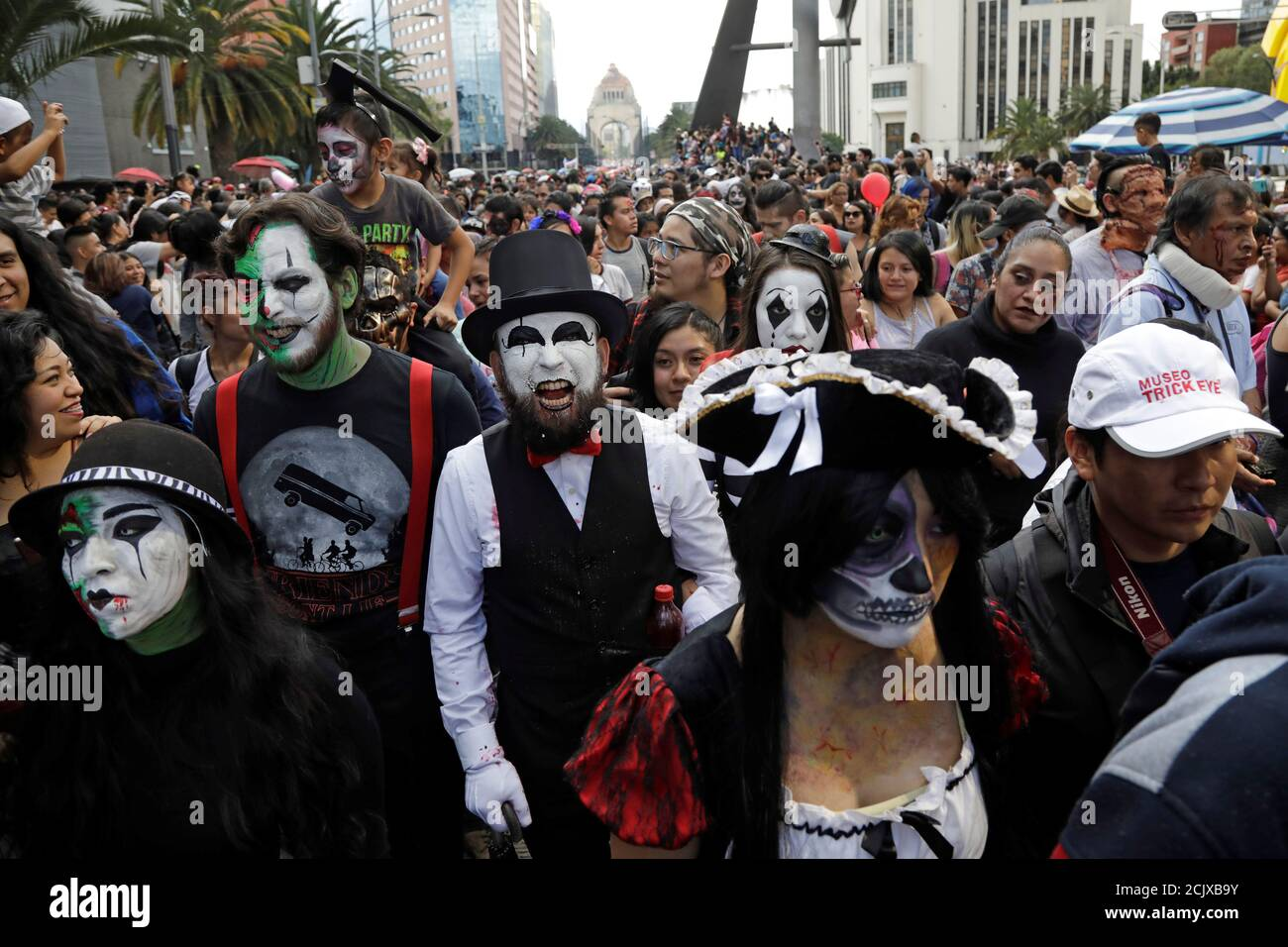 People take part in the annual Zombie Walk in Mexico City, Mexico October 19, 2019. REUTERS/Luis Cortes Stock Photo