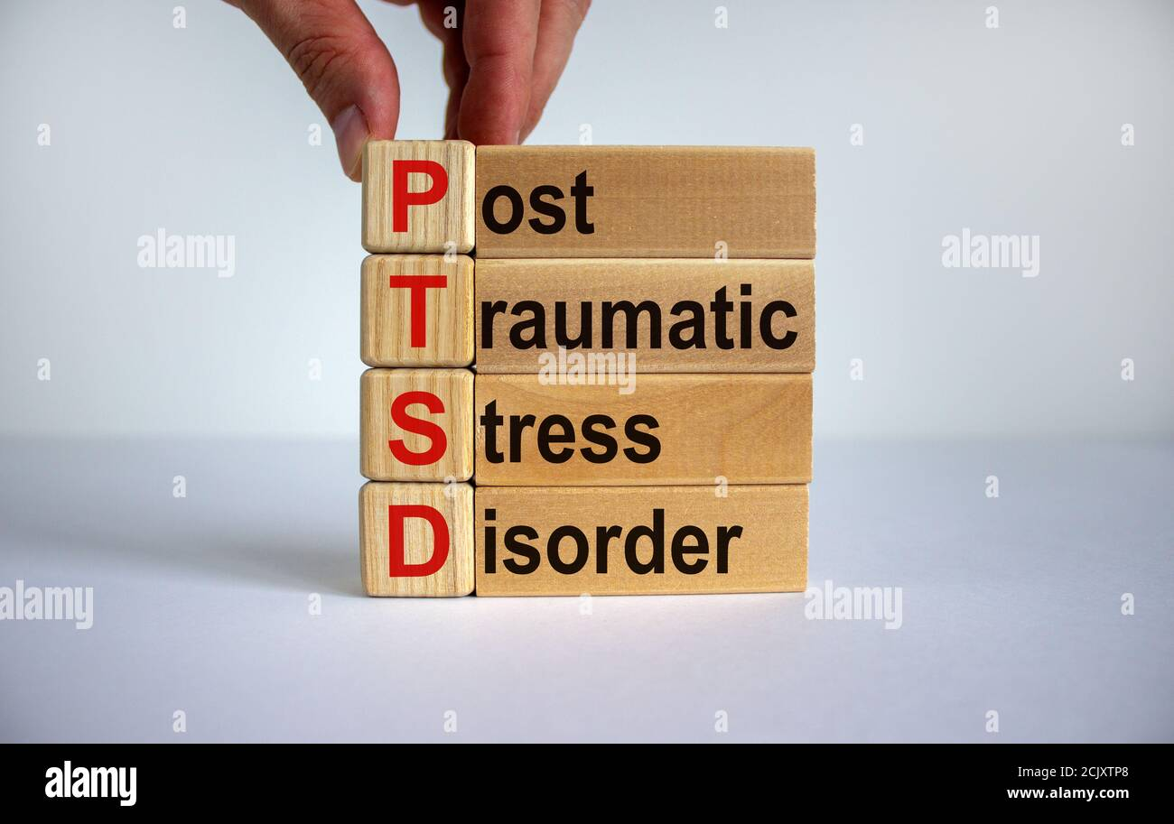 Concept words 'PTSD, post-traumatic stress disorder' on cubes and blocks on a beautiful white background. Copy space. Stock Photo