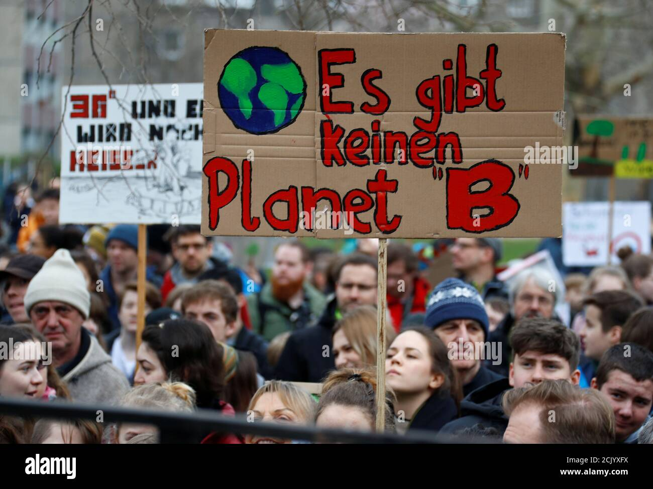 "Demonstrators take part in a ""Fridays for Future"" protest claiming for urgent measures to combat climate change, in Berlin, Germany, March 29, 2019. The sign reads ""There is no Planet B"". REUTERS/Fabrizio Bensch Stock Photo"
