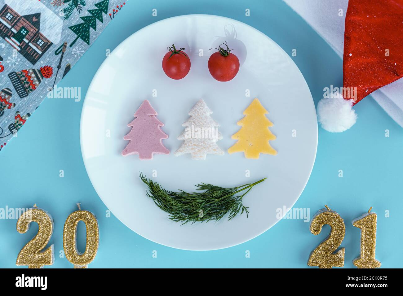 Christmas Ty 2021 Products Xmas Winter New Year Festive Table And Treats Food Concept Blue Background With Plate With Different Products In Shape Of Christmas Tree 2021 Stock Photo Alamy