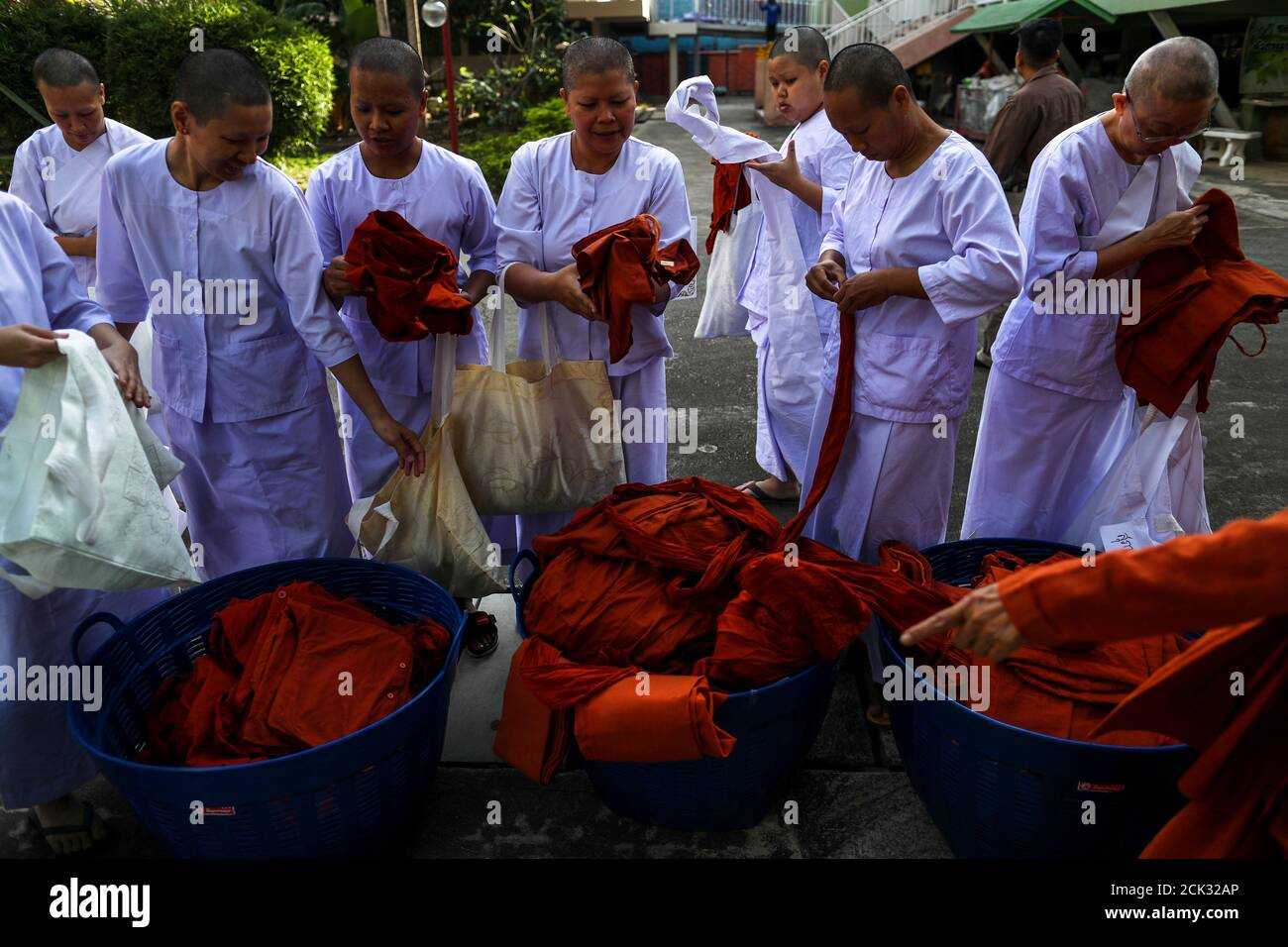Thai Women Devotees Wearing White Robes Return Saffron Robes After Ending Their Novice Monkhood At The Songdhammakalyani Monastery Nakhon Pathom Province Thailand December 14 2018 Officially Only Men Can Become Monks And