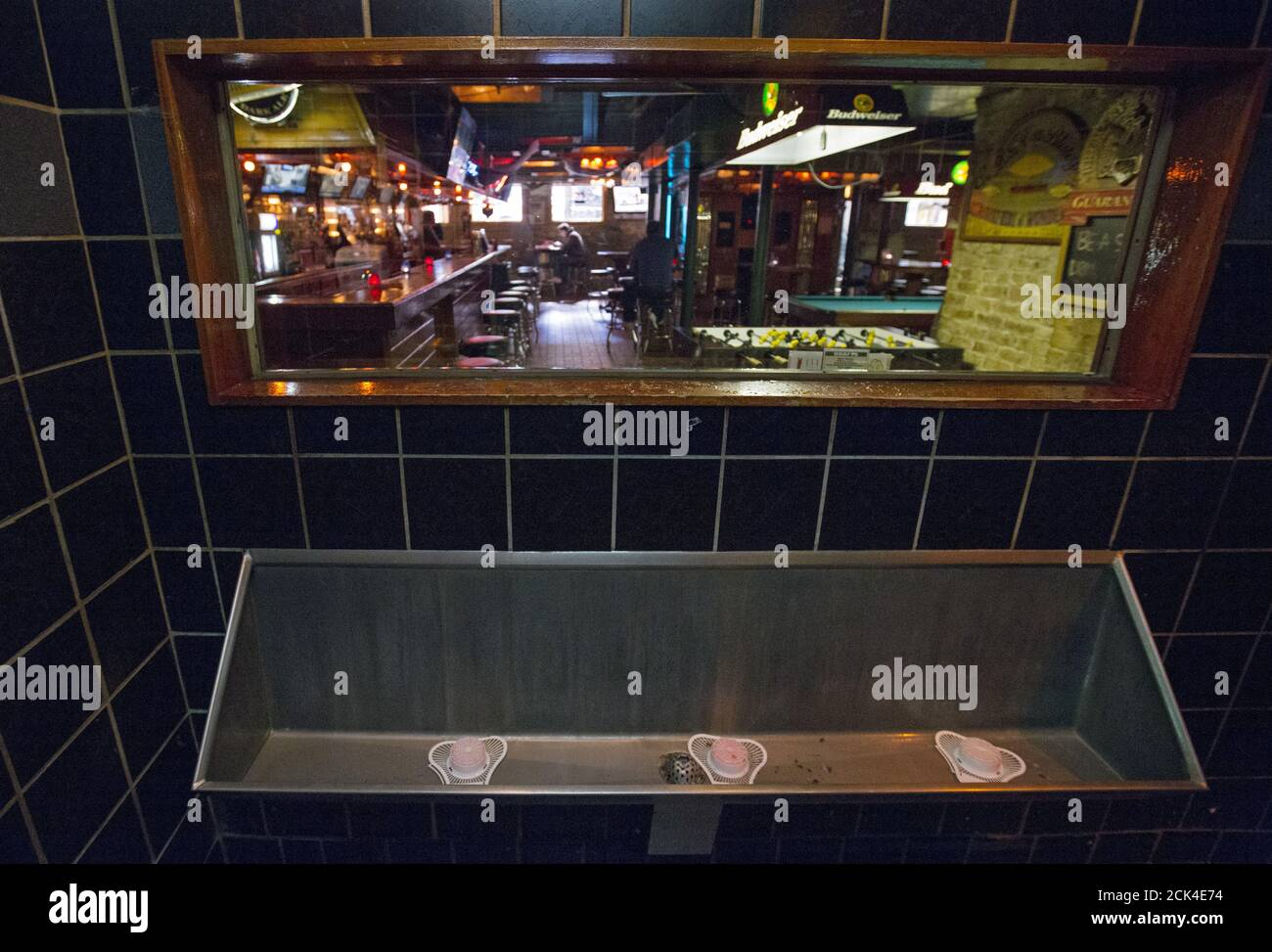A One Way Mirror Is Seen Above The Urinal At Streeter S Tavern In Chicago Illinois United