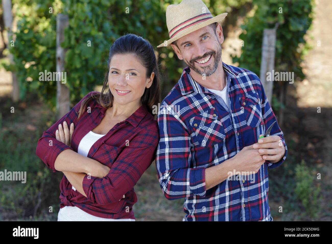 vineyard female and male staff looking at camera Stock Photo