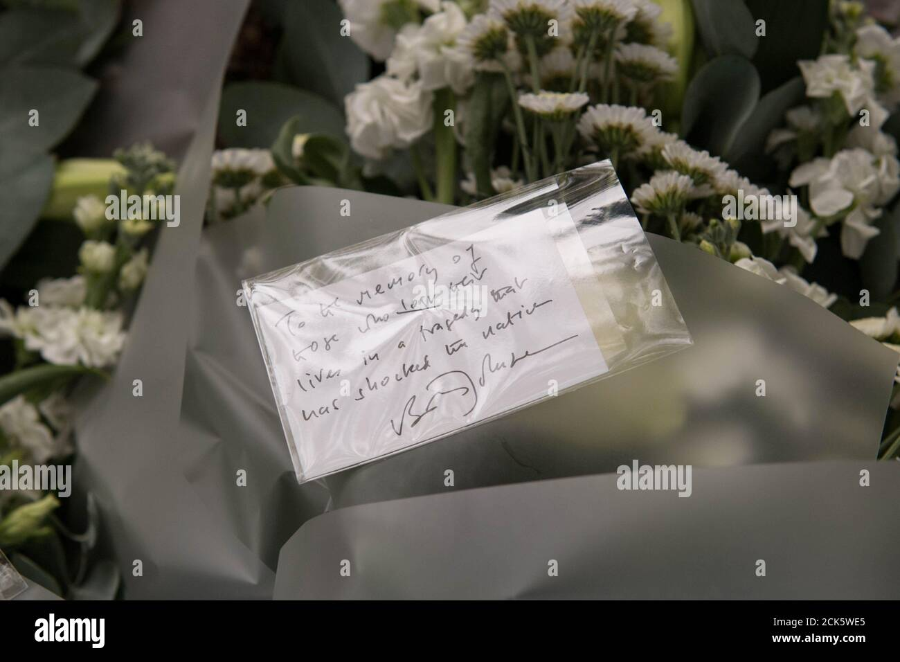 A note on flowers left by Prime Minister Boris Johnson during a visit to Thurrock Council Offices is seen in Grays, Britain, October 28, 2019. Stefan Rousseau/Pool via REUTERS Stock Photo