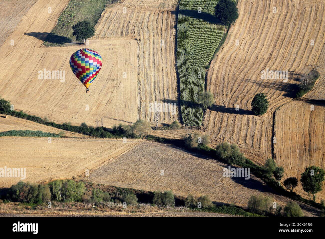A hot air balloon flies during a hot air ballooning event in Todi, Italy, July 29, 2017. REUTERS/Alessandro Bianchi Stock Photo