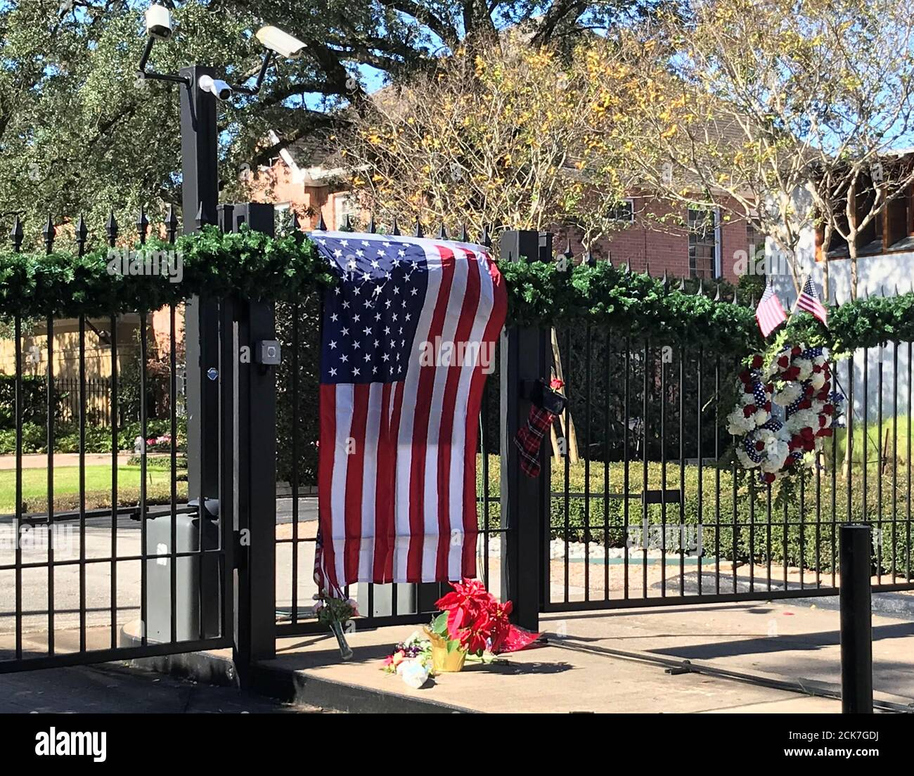 A flag is draped over the gate to the neighborhood of the home of former President George H.W. Bush, a day after he passed away in Houston, Texas, U.S. December 1, 2018.  REUTERS/Gary McWilliams Stock Photo