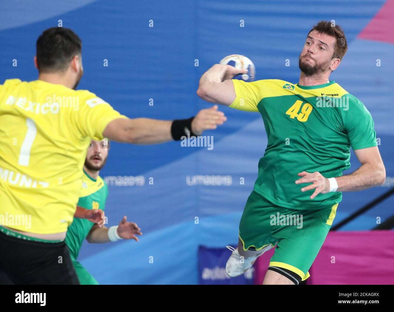 XVIII Pan American Games - Lima 2019  - Handball - Men Bronze Medal Match - Brazil Vs. Mexico - Sports Center 1, Lima, Peru - August 5, 2019. Brazil's Raul Nantes in action with Mexico's Francisco Muniz. REUTERS/Sergio Moraes Stock Photo