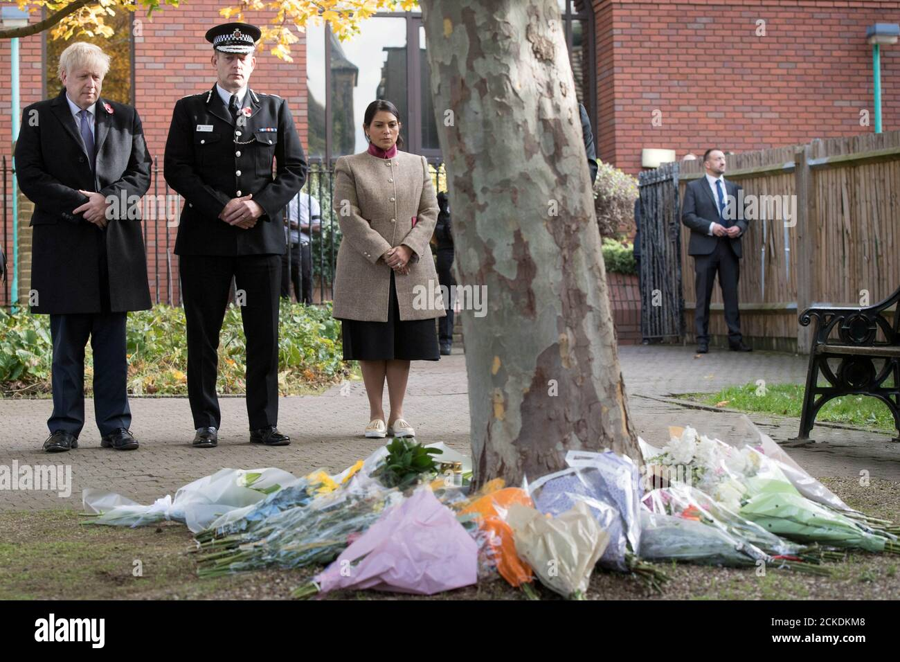 Prime Minister Boris Johnson stands with the Chief Constable of Essex Police, Ben-Julian Harrington, and Home Secretary Priti Patel, after laying flowers during a visit to Thurrock Council Offices in Grays, Britain, October 28, 2019. Stefan Rousseau/Pool via REUTERS Stock Photo