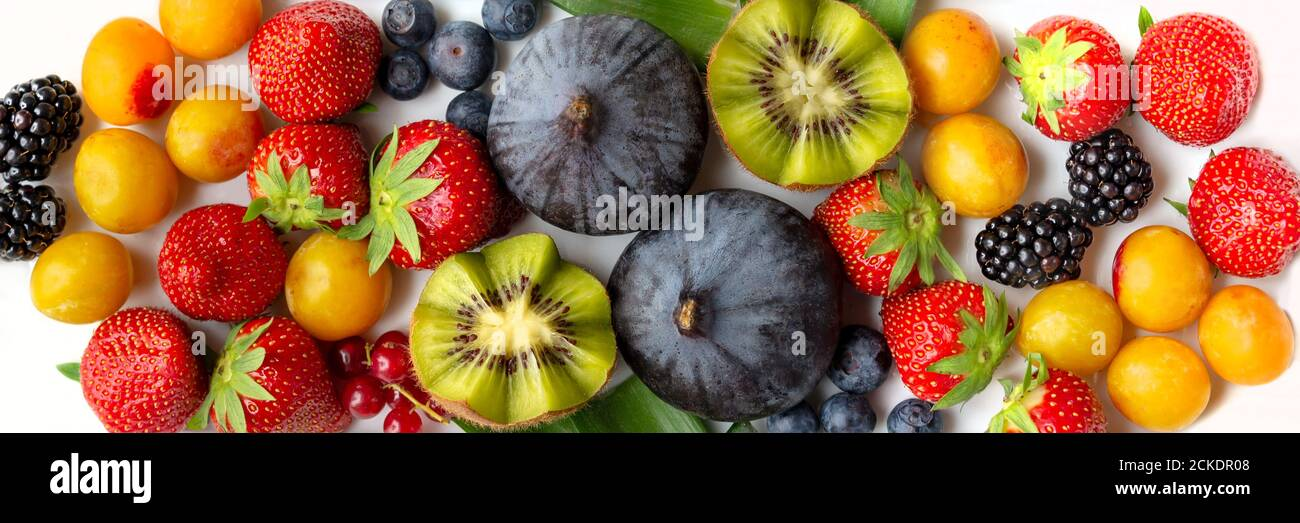 Panoramic colorful fruits assortment background, healthy diet and food web banner Stock Photo