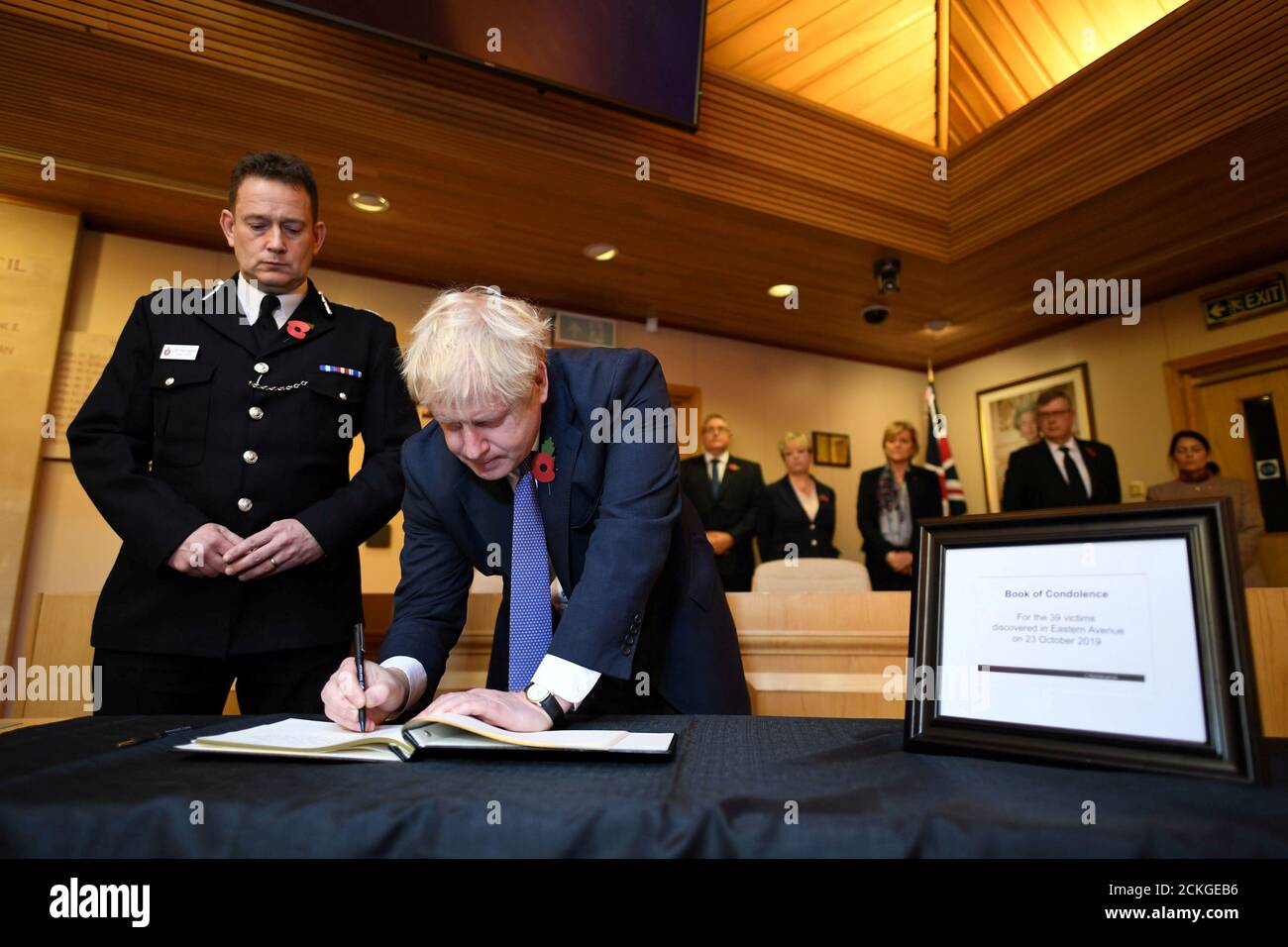 Britain's Prime Minister Boris Johnson signs a book of condolence during a visit to Thurrock Council Offices in Grays, Britain October 28, 2019. Stefan Rousseau/Pool via REUTERS     TPX IMAGES OF THE DAY Stock Photo