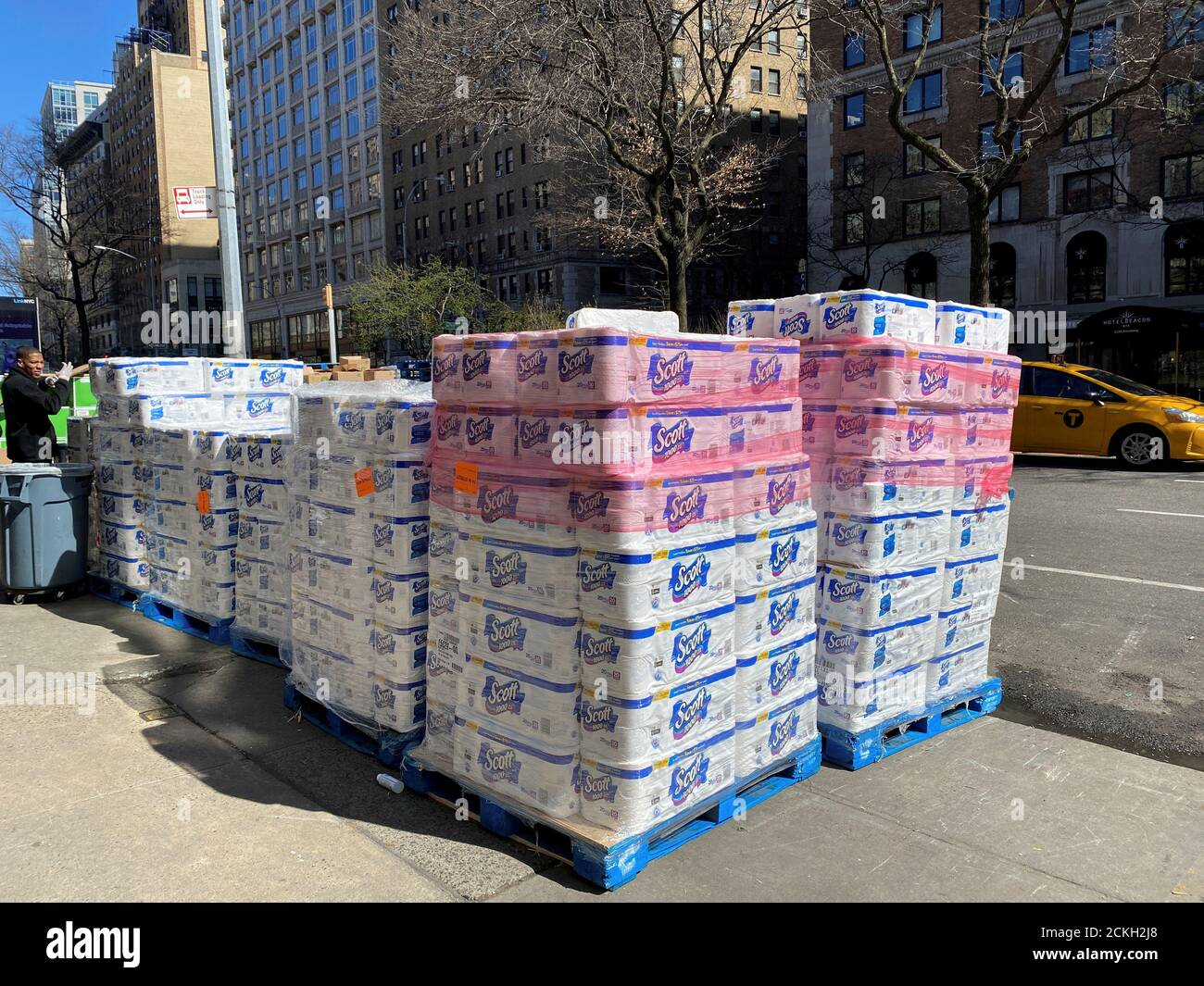 Pallets of toilet paper fill the sidewalk in front of grocer Fairway  in Manhattan on Sunday after panicky shoppers depleted shelves, amid fears of the global growth of coronavirus cases, in Manhattan, New York, U.S. March 15, 2020. REUTERS/Anna Driver Stock Photo