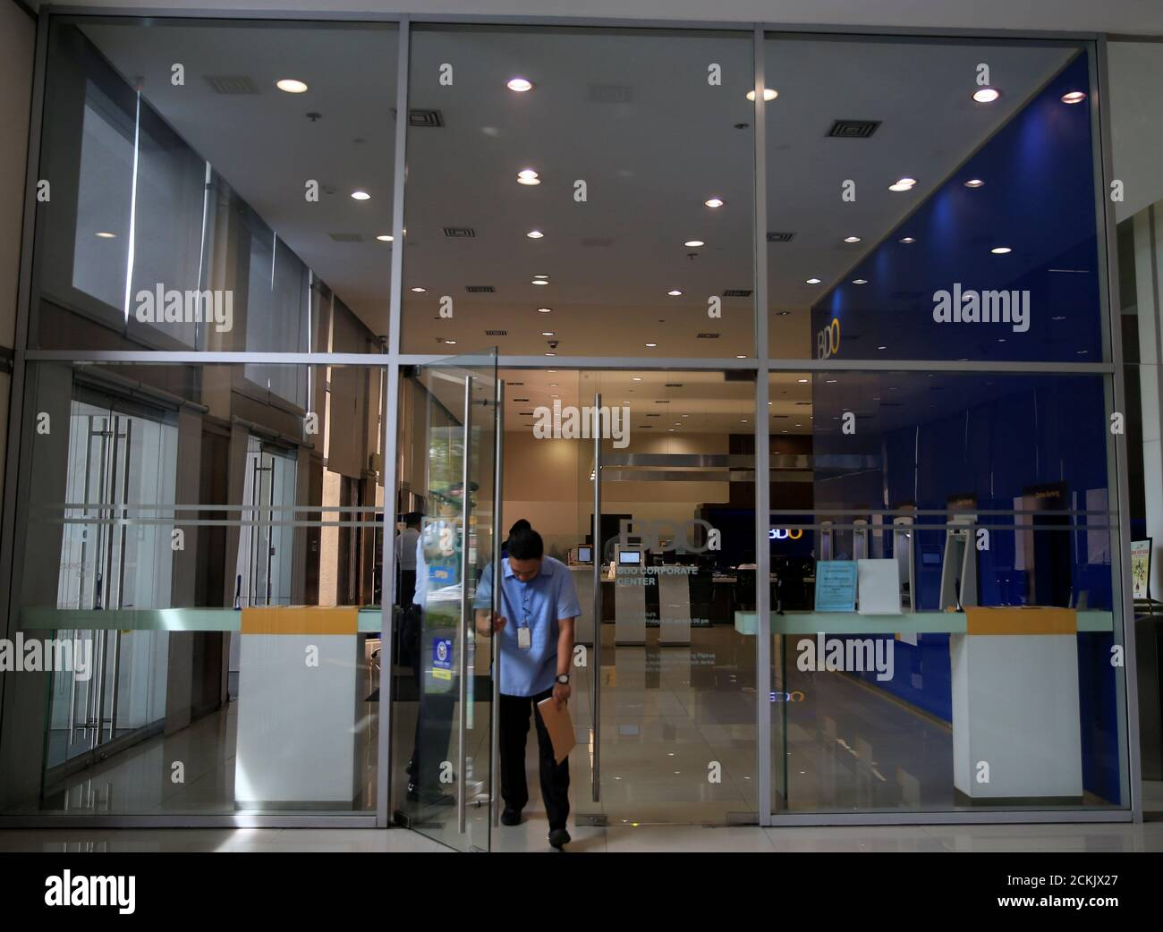 A Man Walk Out Of The Philippines Top Lender Banco De Oro Bdo Unibank Inc After Doing A Transanction At A Main Building In Makati City Metro Manila Philippines June 23 2016