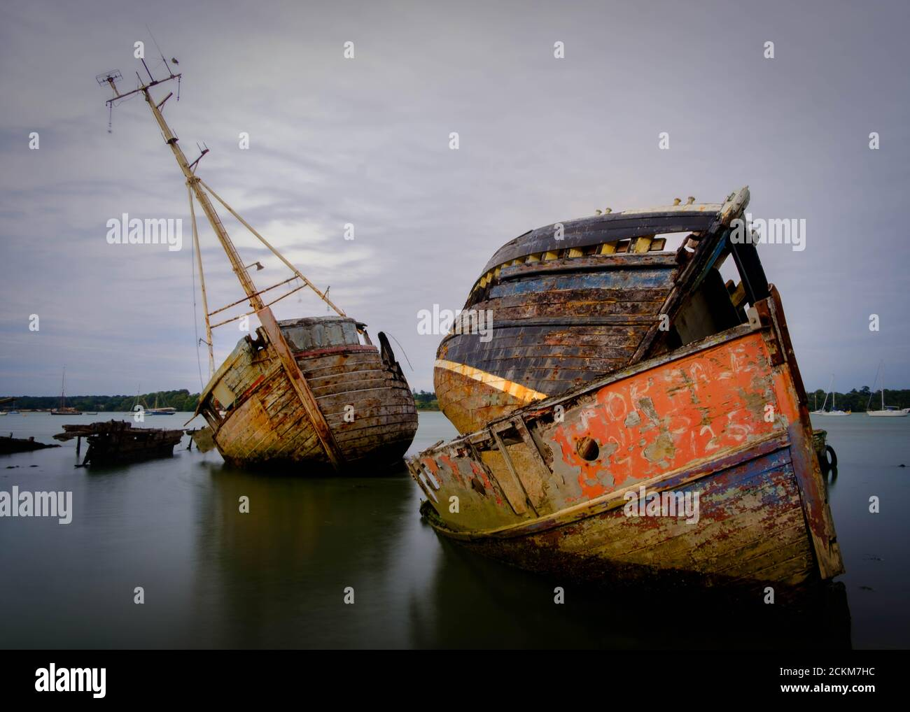 Boat graveyard at Pin Mill on the river Orwell, Shotley Peninsula, near Ipswich, Suffolk, UK Stock Photo