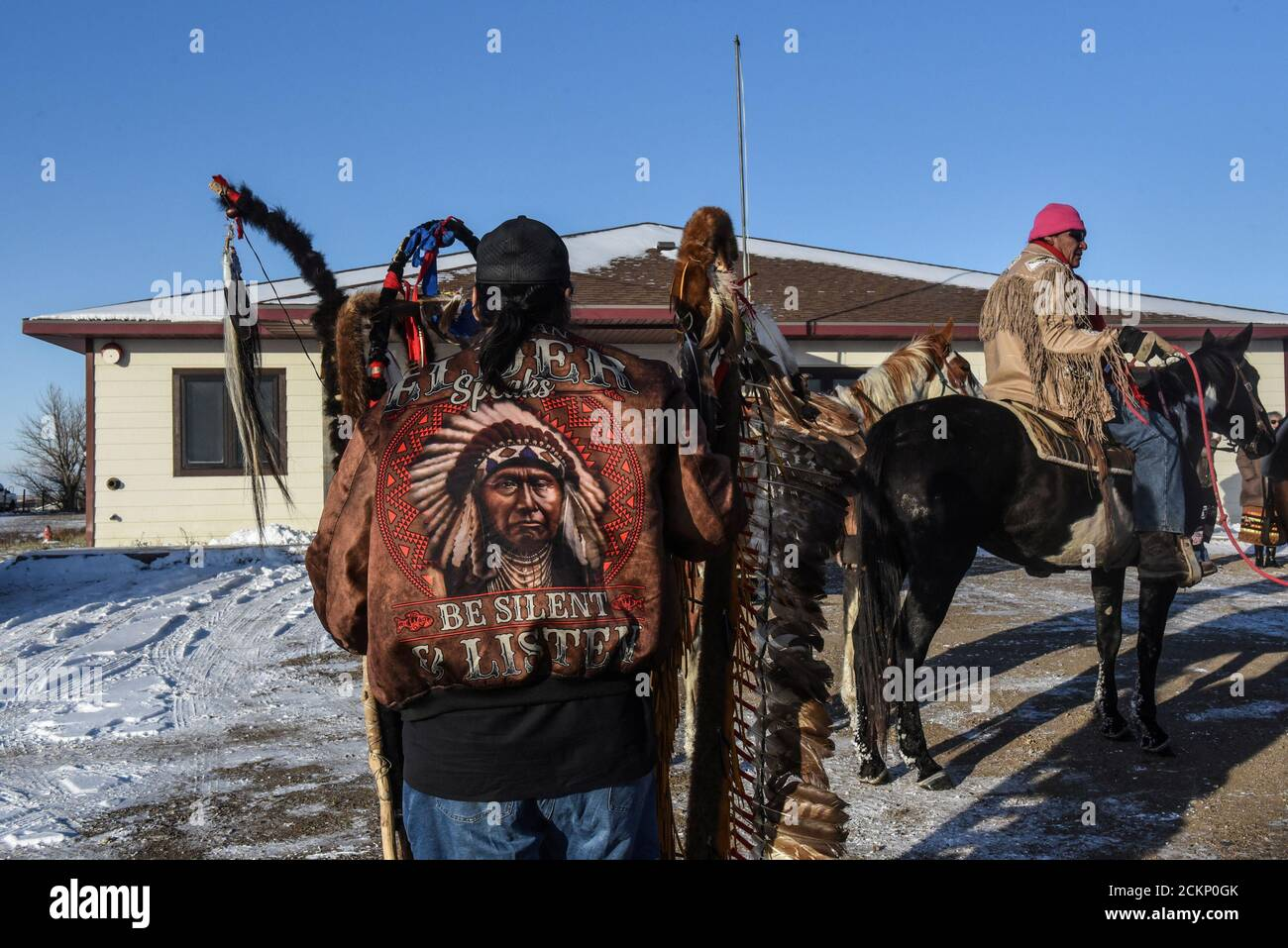 Lakota riders arrive at the government building where they will meet Brad Upton, descendant of the commander of the Wounded Knee massacre on the Cheyenne River reservation in Eagle Butte, South Dakota, November 6, 2019. Picture taken November 6, 2019 REUTERS/Stephanie Keith Stock Photo