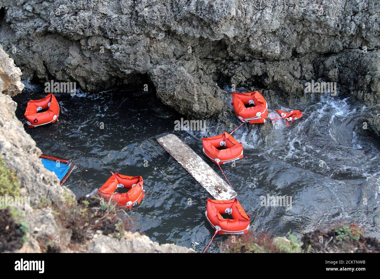 Flotation devices are seen in the area where a migrant boat capsized off the Italian coast, on the island of Lampedusa, Italy, November 24, 2019. REUTERS/Mauro Buccarello Stock Photo