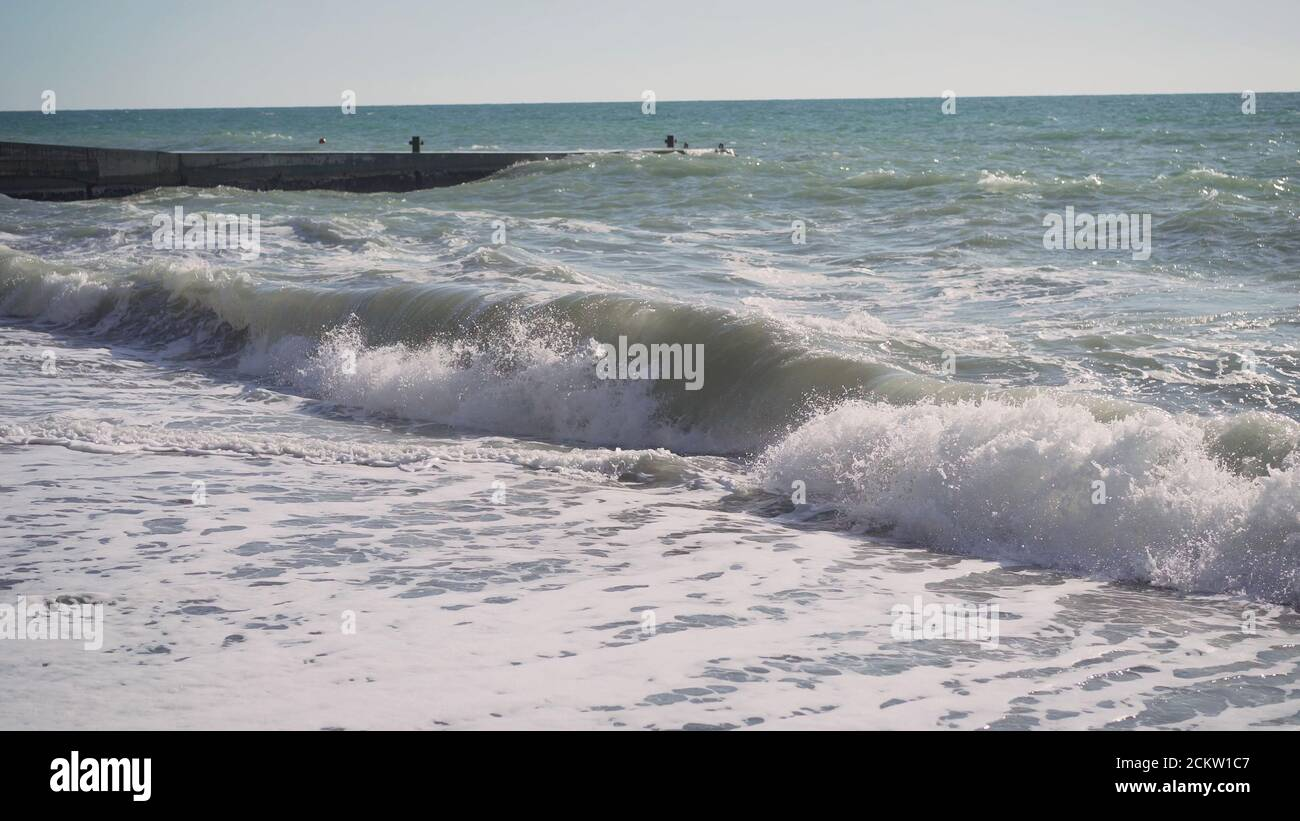 Waves at Rejnisfjara black sand beach, slow motion . Raging waves on the black sea in slow motion. Stock Photo