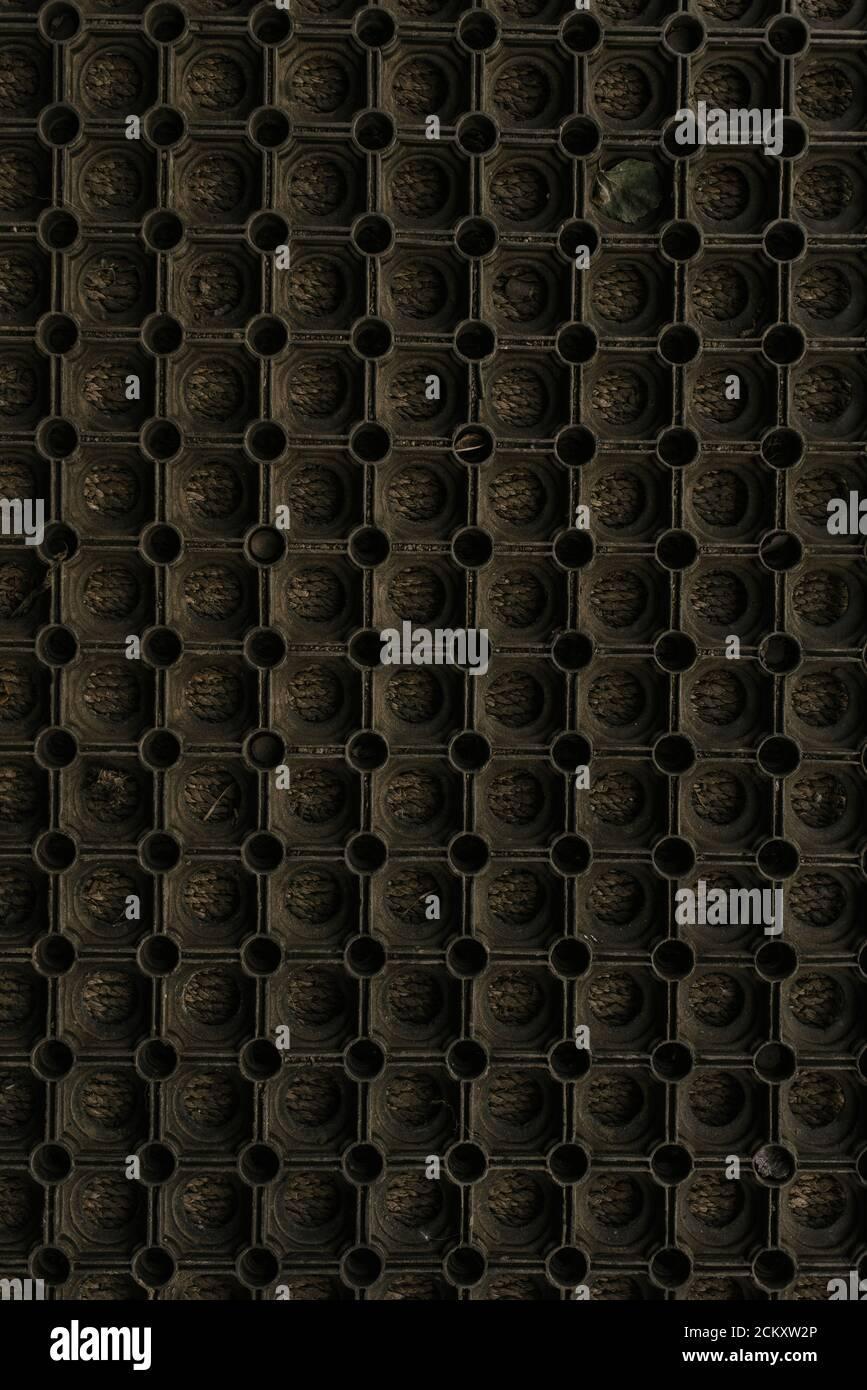 Black brown dark background round circles. honeycomb Stock Photo