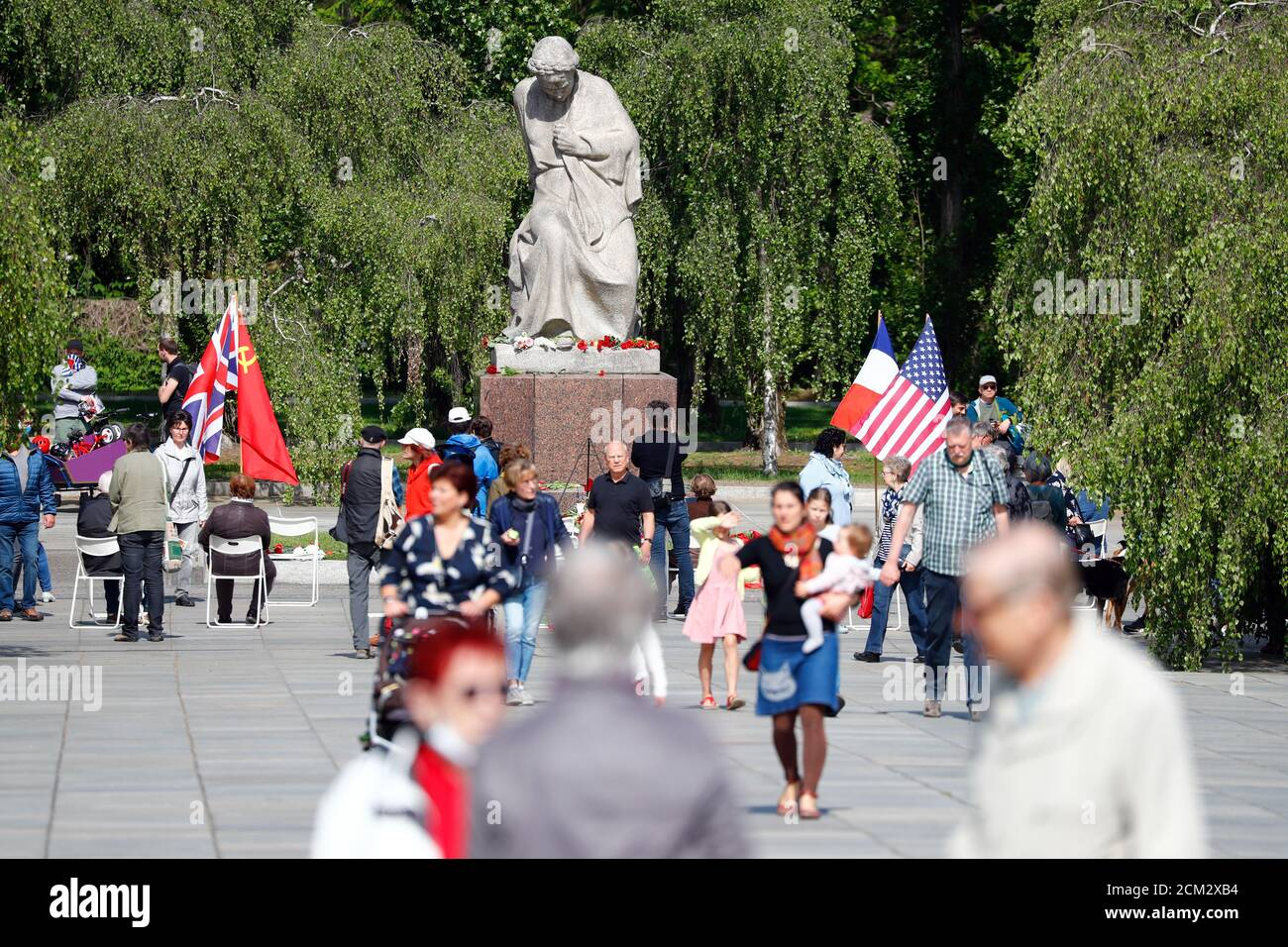 People gather at the Soviet War Memorial at Treptower Park, to mark Victory Day and the 75th anniversary of the end of World War Two, in Berlin, Germany, May 8, 2020. REUTERS/Fabrizio Bensch Stock Photo