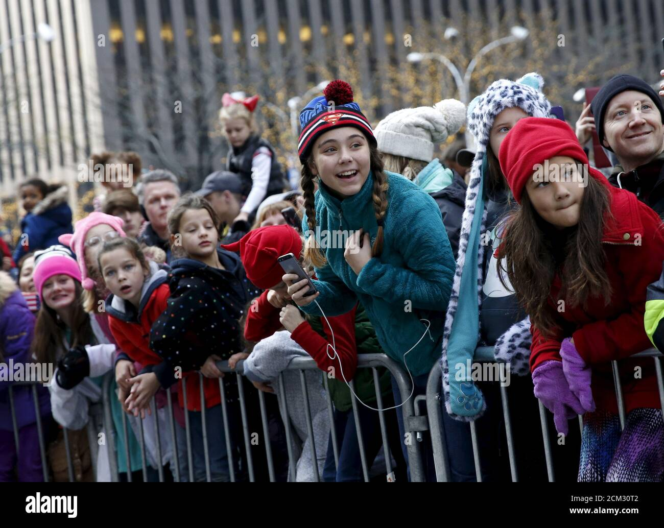 People watch floats make their way down 6th avenue during the 89th Macy's Thanksgiving Day Parade in the Manhattan borough of New York, November 26, 2015. REUTERS/Shannon Stapleton Stock Photo