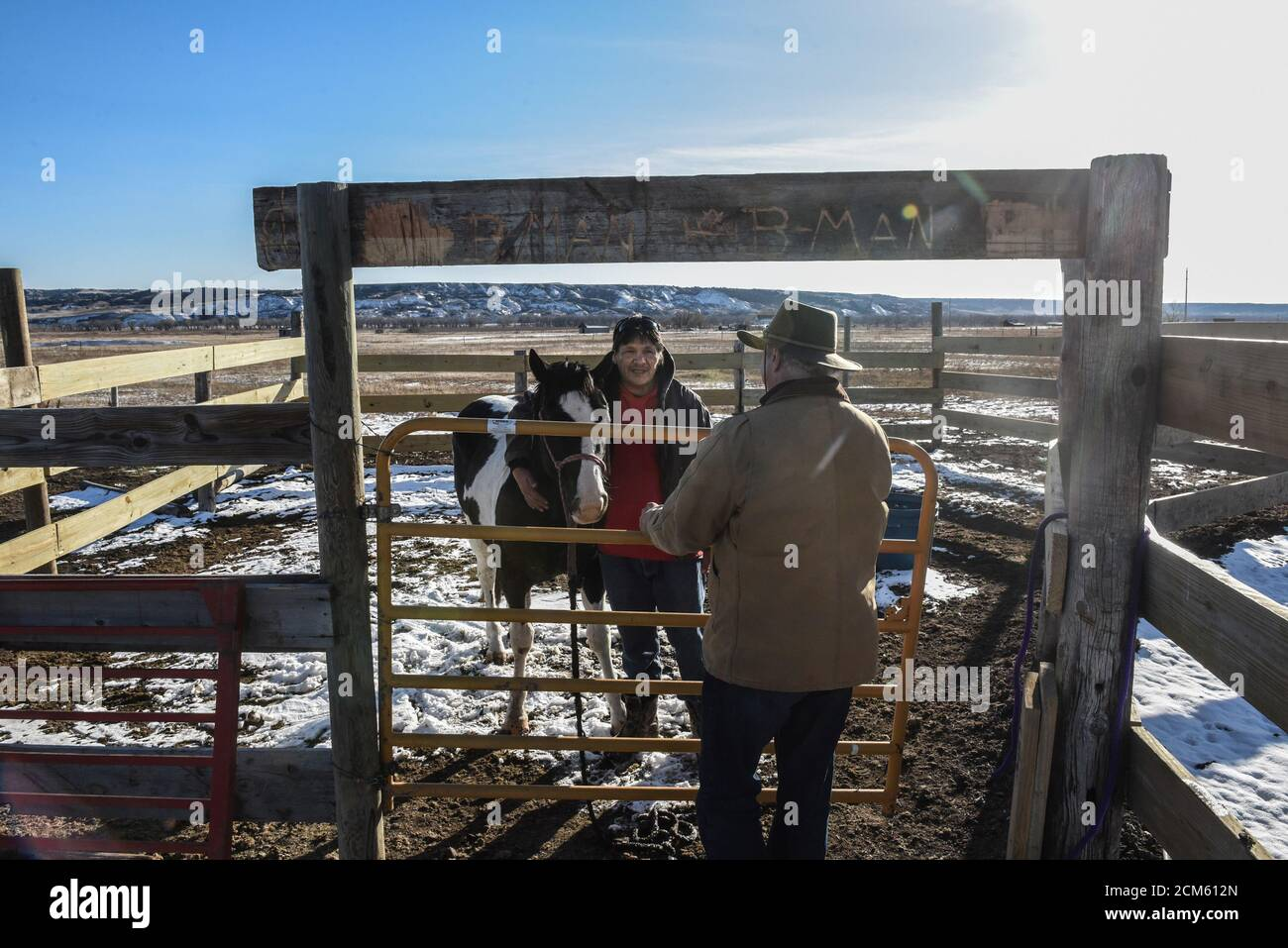 Roderick Dupris (with horse) speaks to Brad Upton, descendant of the commander of the Wounded Knee massacre, on the Cheyenne River reservation in Bridger, South Dakota, November 7, 2019. Upton traveled to the reservation to apologize for the actions of his great grandfather who was the commander of the massacre that happened in 1890. REUTERS/Stephanie Keith Stock Photo