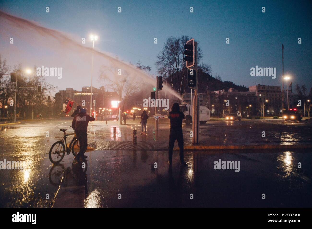 SANTIAGO, CHILE - SEPTEMBER 11, 2020 - A police water cannon disperses protesters against Sebastian Pinera's government. Hundreds of people came to th Stock Photo