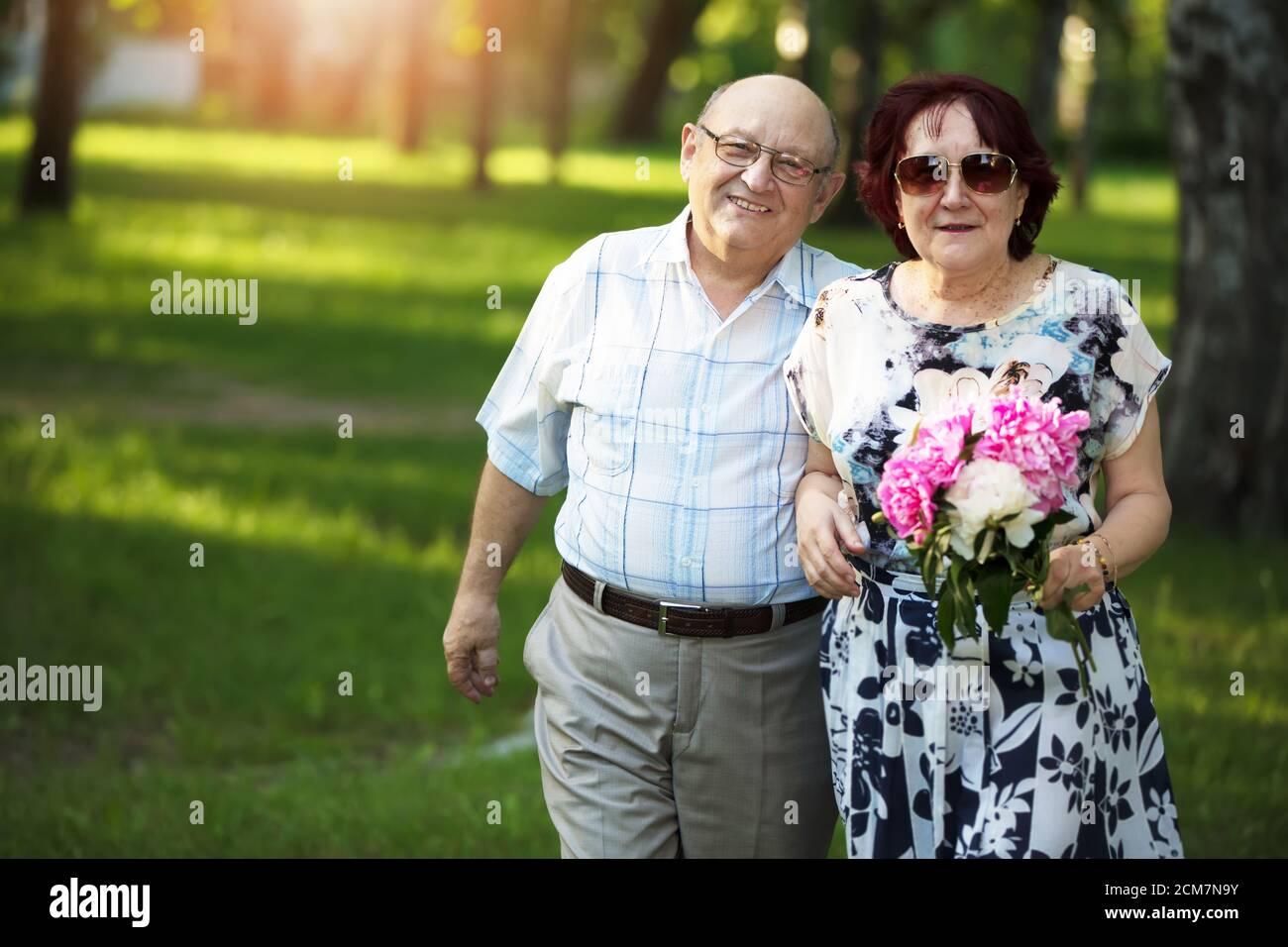 Happy elderly couple. Handsome man and woman senior citizens. Husband and wife of old age for a walk. Stock Photo