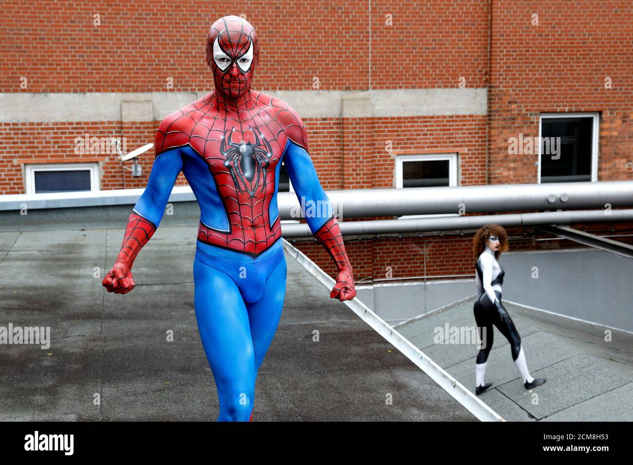 GEEK ART - Bodypainting and Transformaking: Spider-Man and Spider-Gwen photoshooting with Patrick Kiel and Lena Kiel at the Hefehof in Hamelin on September 15, 2020 - A project by the photographer Tschiponnique Skupin and the bodypainter Enrico Lein Stock Photo