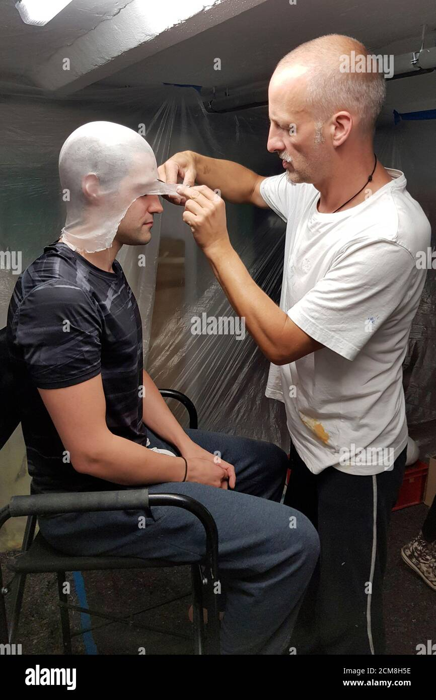 GEEK ART - Bodypainting and Transformaking: Enrico Lein and Patrick Kiel preparing for the Spider-Man and Spider-Gwen photoshooting in Hamelin on September 15, 2020 - A project by the photographer Tschiponnique Skupin and the bodypainter Enrico Lein Stock Photo