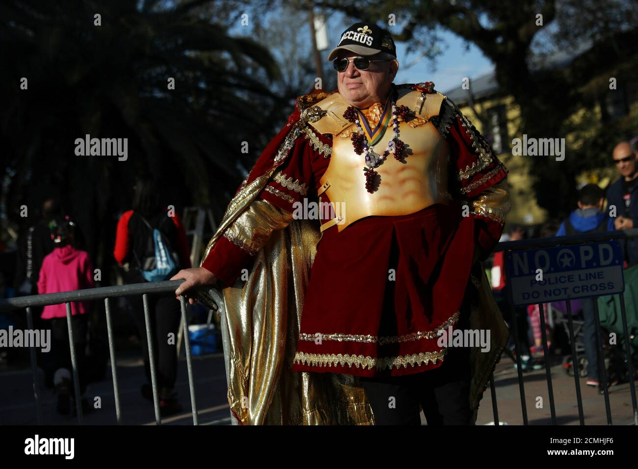 A man waits for the Bacchus parade to begin during Mardi Gras in New Orleans, Louisiana U.S., February 26, 2017. REUTERS/Shannon Stapleton Stock Photo