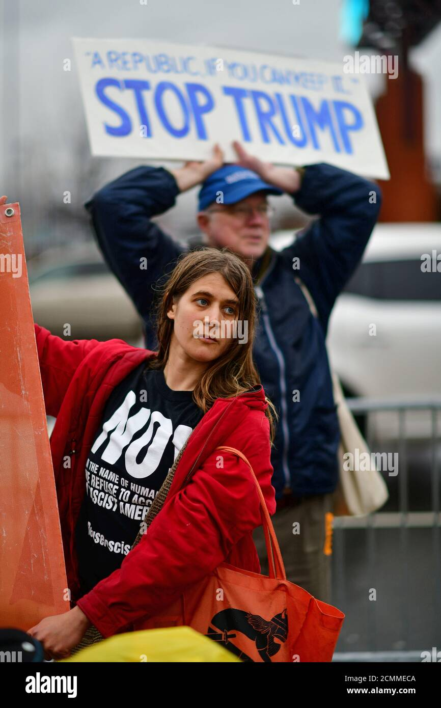 Lucy Koelle and John Gummere protest outside Lincoln Financial Field due to the visit by U.S. President Donald Trump at the Army-Navy football game in Philadelphia, Pennsylvania, U.S. December 14, 2019.  REUTERS/Mark Makela Stock Photo