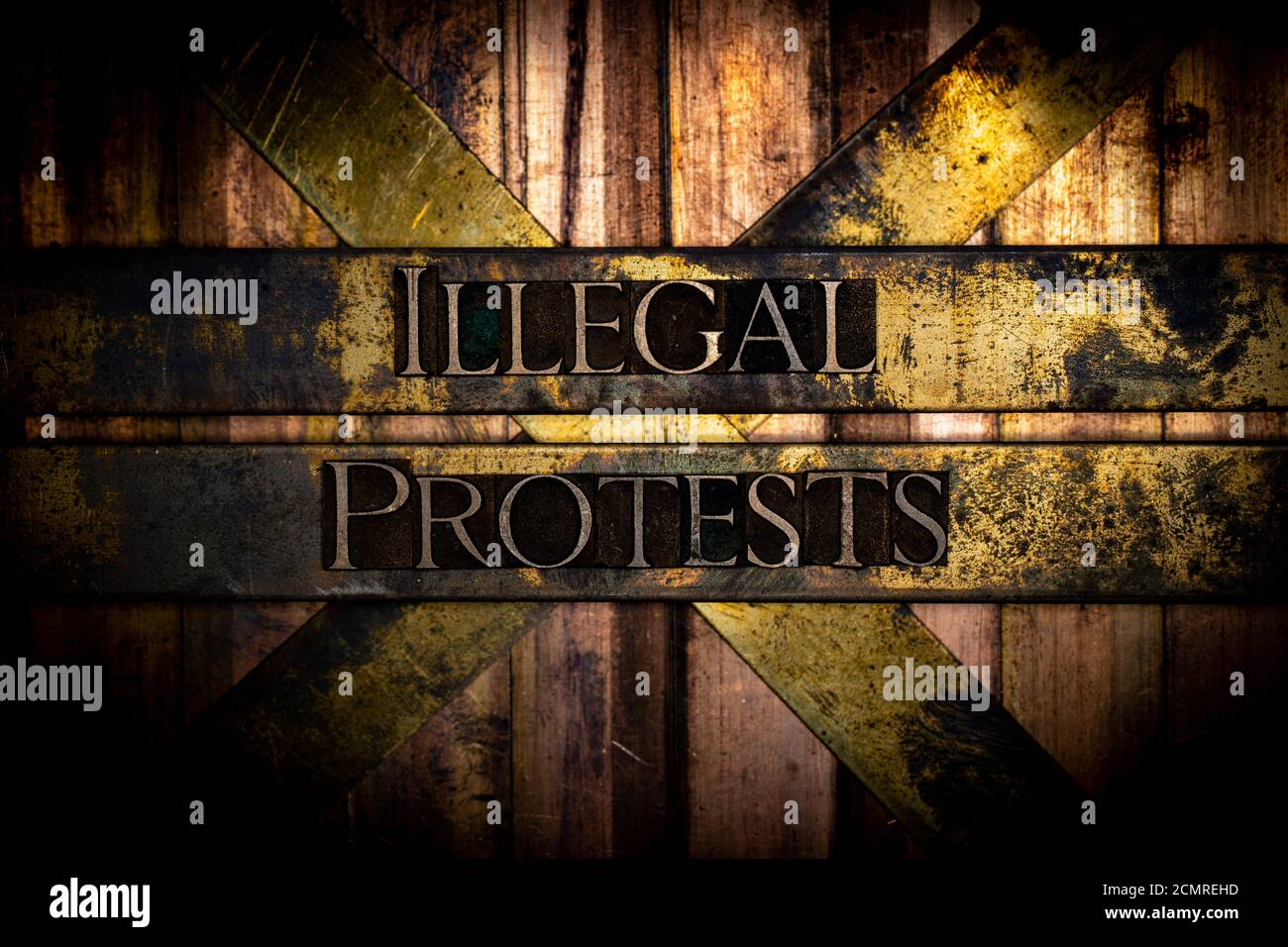 Illegal Protests text formed with real authentic typeset letters on vintage textured silver grunge copper and gold background Stock Photo