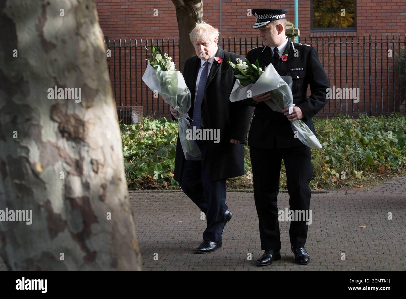 Prime Minister Boris Johnson walks with the Chief Constable of Essex Police, Ben-Julian Harrington, ahead of laying flowers during a visit to Thurrock Council Offices in Grays, Britain, October 28, 2019. Stefan Rousseau/Pool via REUTERS Stock Photo