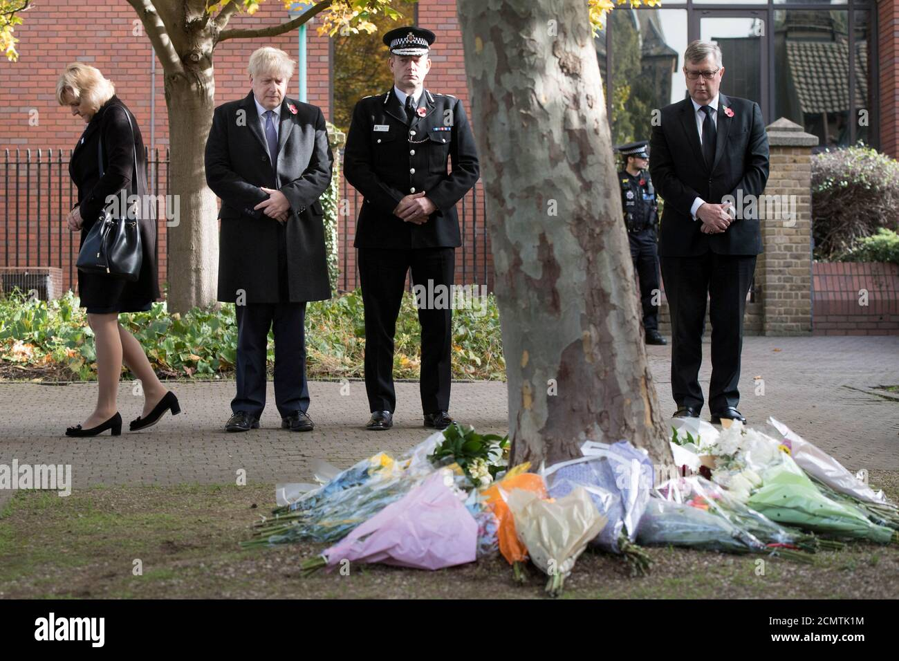 Prime Minister Boris Johnson stands with the Chief Constable of Essex Police, Ben-Julian Harrington, after laying flowers during a visit to Thurrock Council Offices in Grays, Britain, October 28, 2019. Stefan Rousseau/Pool via REUTERS Stock Photo