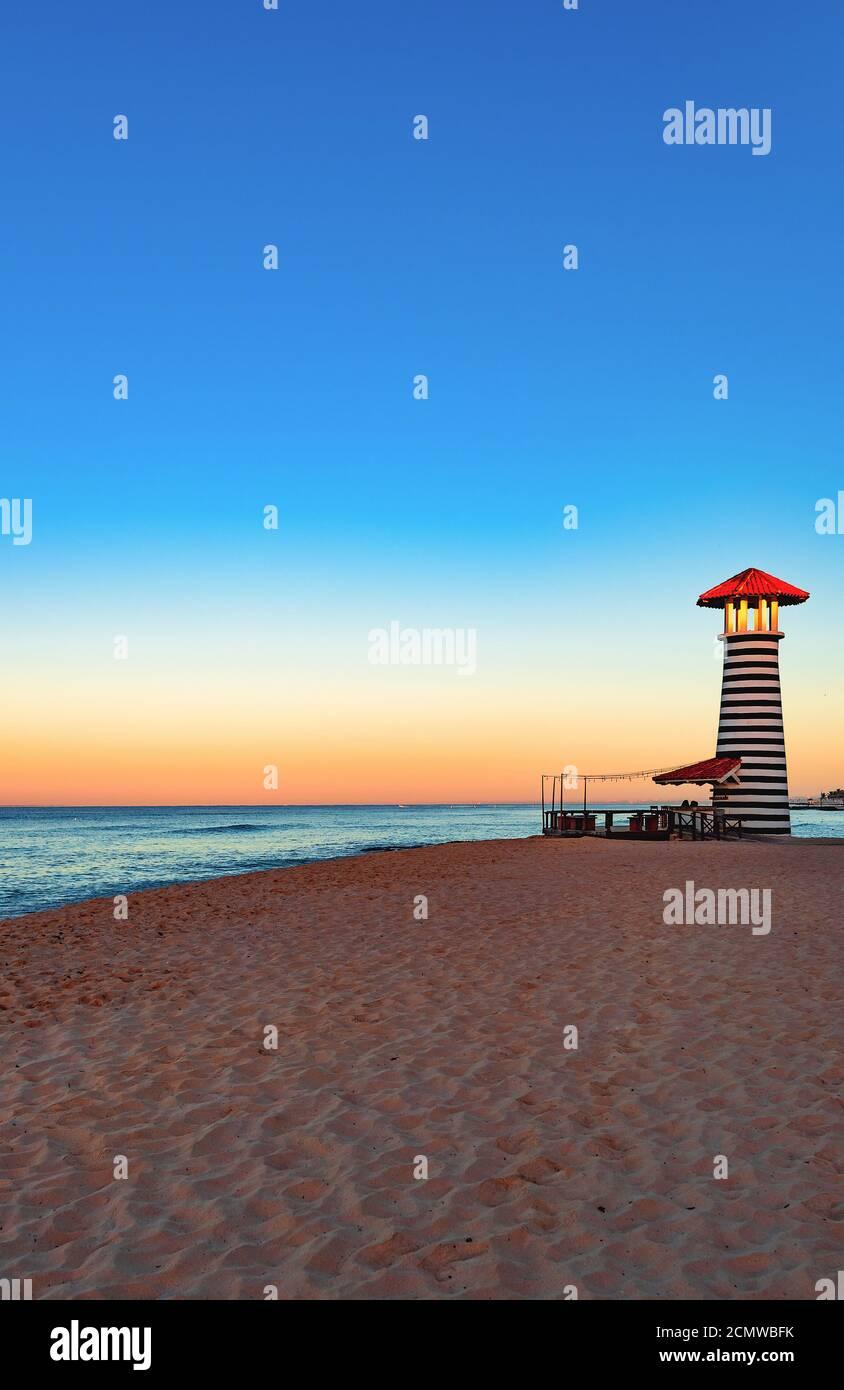 caribbean sea sunrise lighthouse Stock Photo