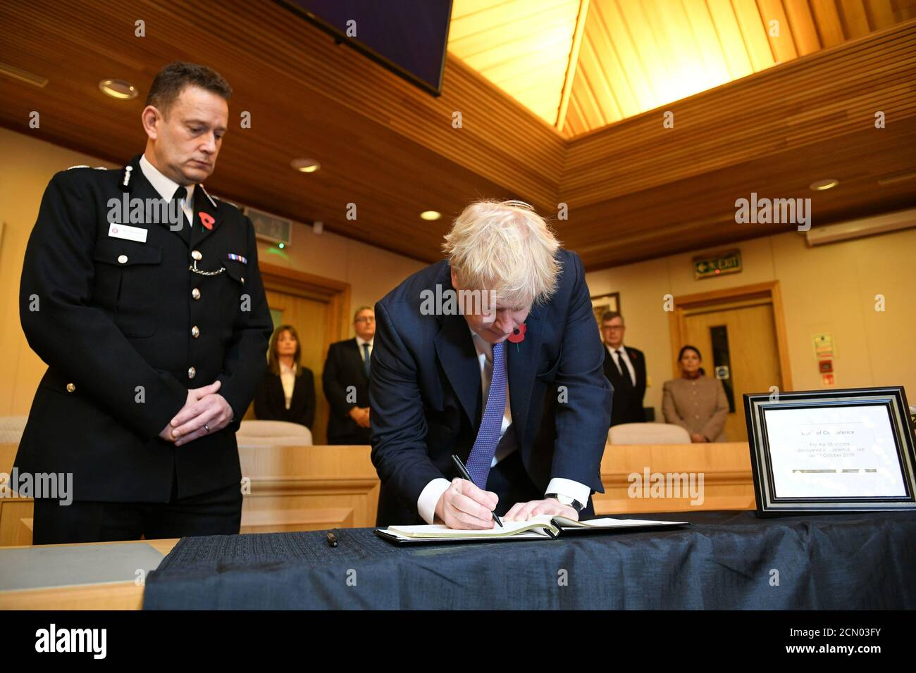 Britain's Prime Minister Boris Johnson signs a book of condolence during a visit to Thurrock Council Offices in Grays, Britain October 28, 2019. Stefan Rousseau/Pool via REUTERS Stock Photo