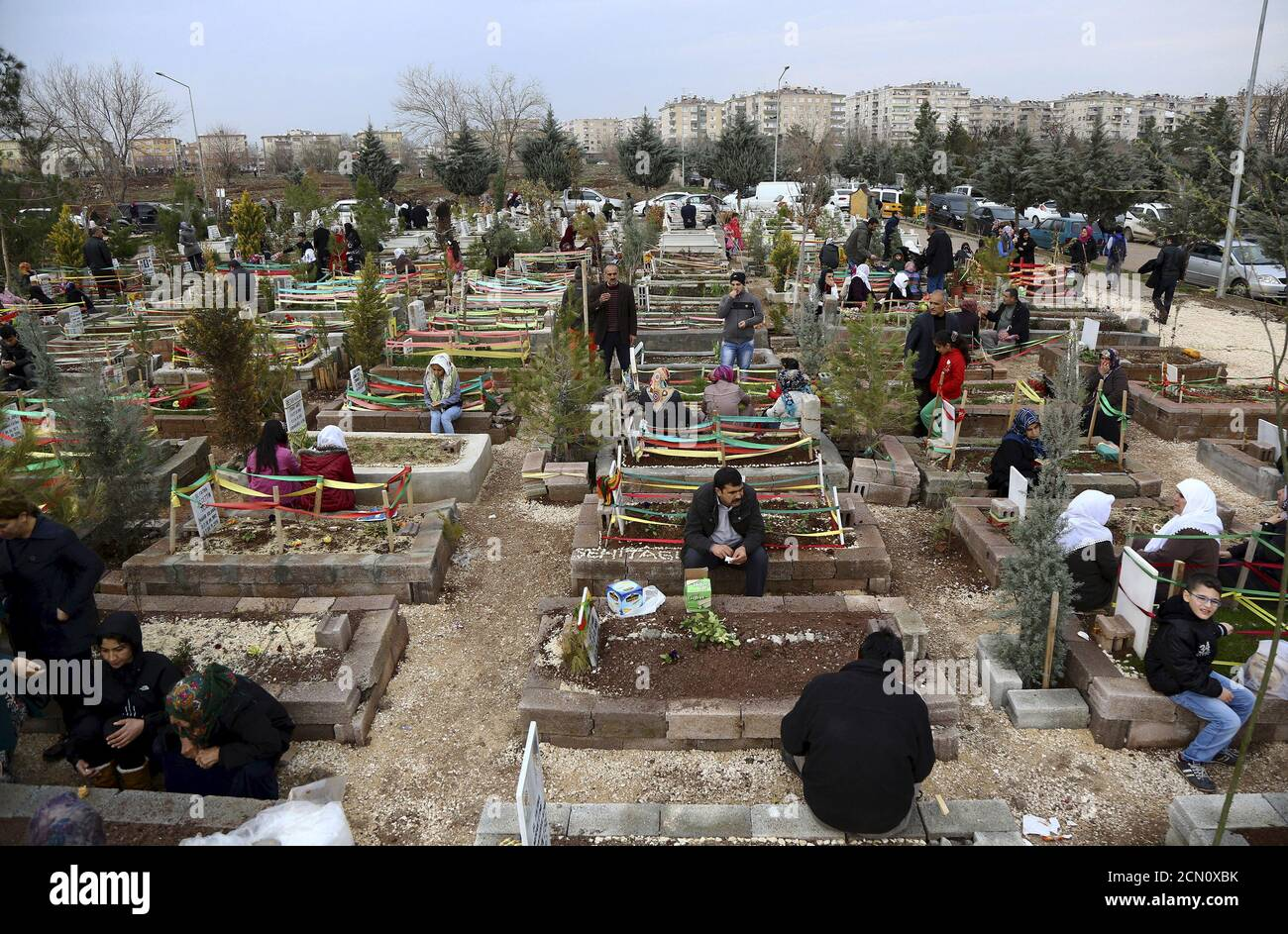 Family members visit the graves of their loved ones, most of them People's Protection Units (YPG) members who were killed during fightings against Islamic State in north Syria, at a cemetery in Diyarbakir, Turkey February 25, 2016. REUTERS/Sertac Kayar Stock Photo