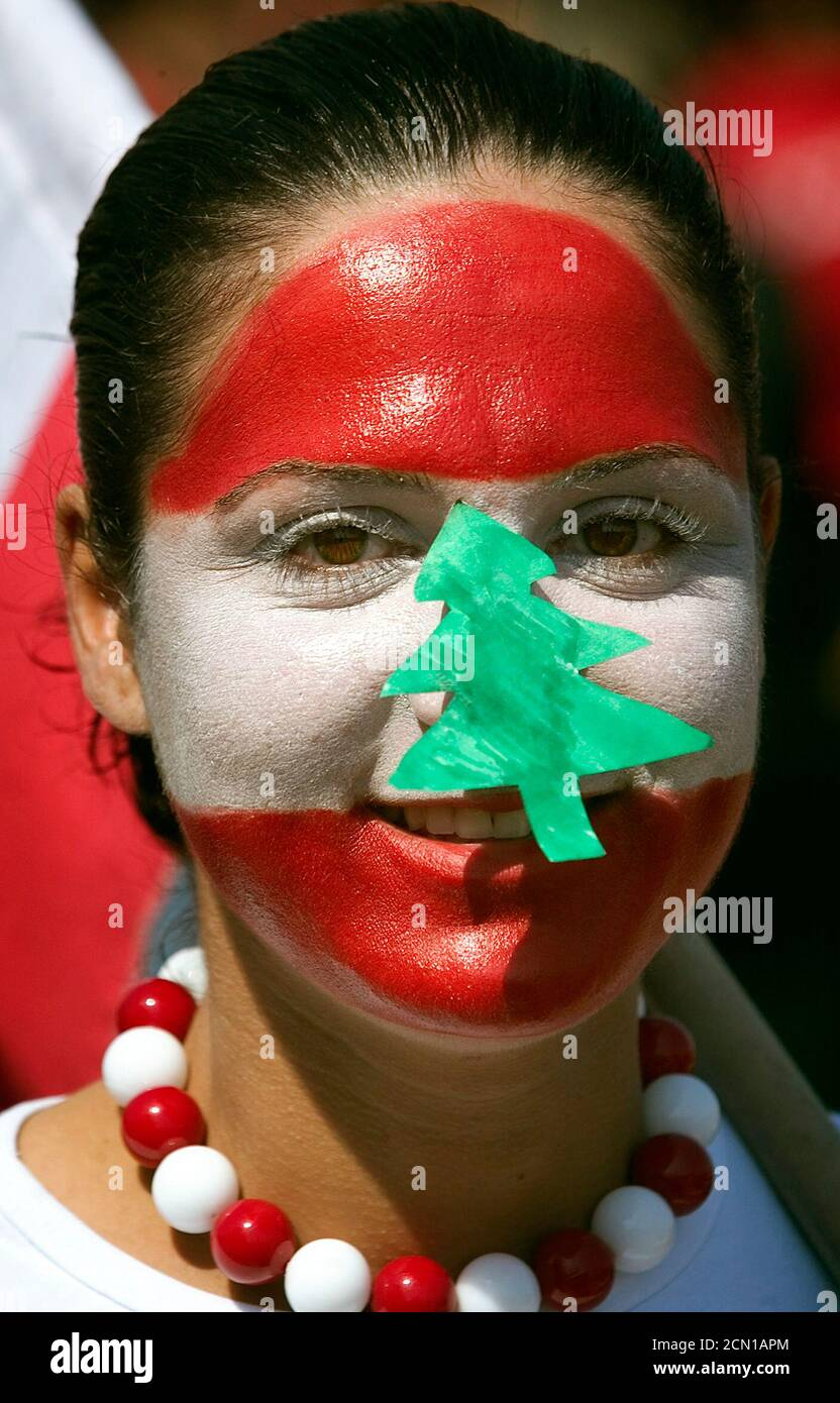 A Lebanese girl with her face painted in Lebanon's national colours attends a rally in Beirut March 14, 2005. Hundreds of thousands of anti-Syrian protesters flooded central Beirut on Monday in what witnesses said was Lebanon's biggest demonstration since former prime minister Rafik al-Hariri's killing exactly a month ago. REUTERS/Damir Sagolj  DS/CCK Stock Photo