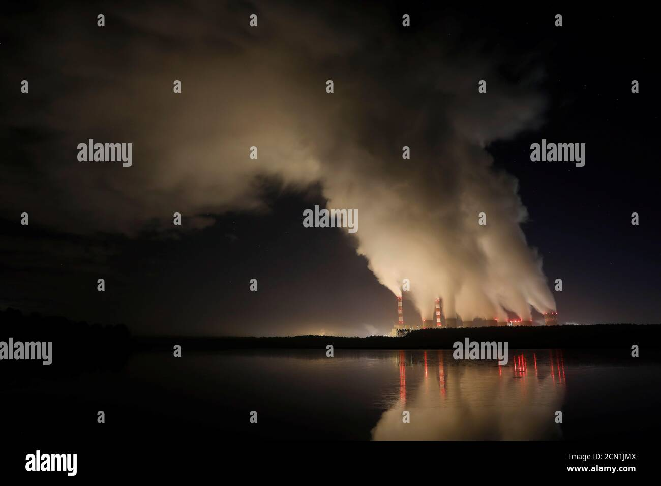 Smoke and steam billows from Belchatow Power Station, Europe's largest coal-fired power plant operated by PGE Group, at night near Belchatow, Poland December 5, 2018. Picture taken December 5, 2018. REUTERS/Kacper Pempel Stock Photo