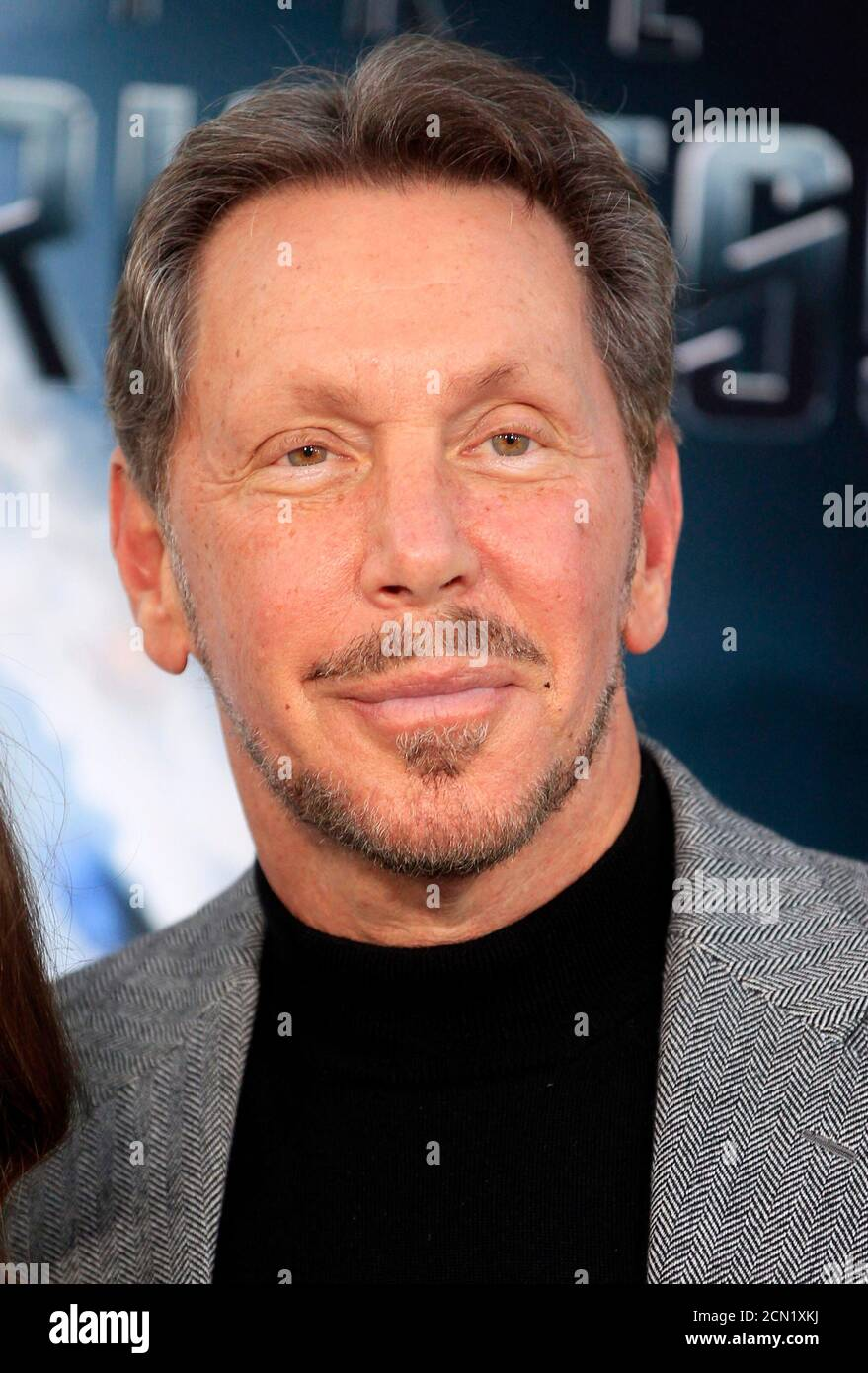 """Oracle CEO Larry Ellison arrives as a guest for the premiere of the new film """"Star Trek Into Darkness"""" in Hollywood May 14, 2013. Ellison's son David is the executive producer of the film. REUTERS/Fred Prouser (UNITED STATES - Tags: ENTERTAINMENT BUSINESS) Stock Photo"""